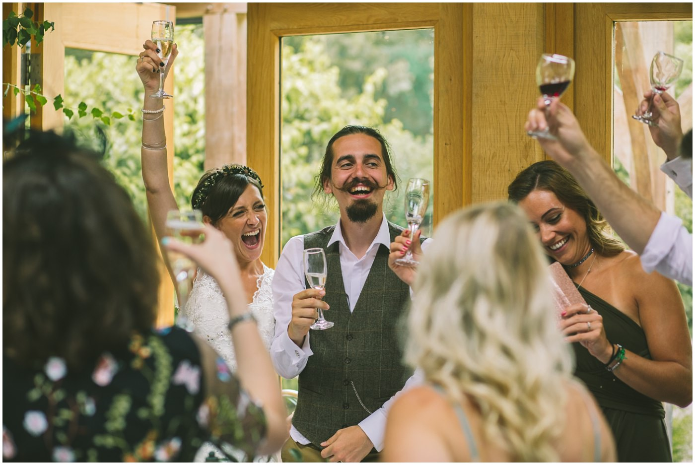 bride and groom raise a glass in toast
