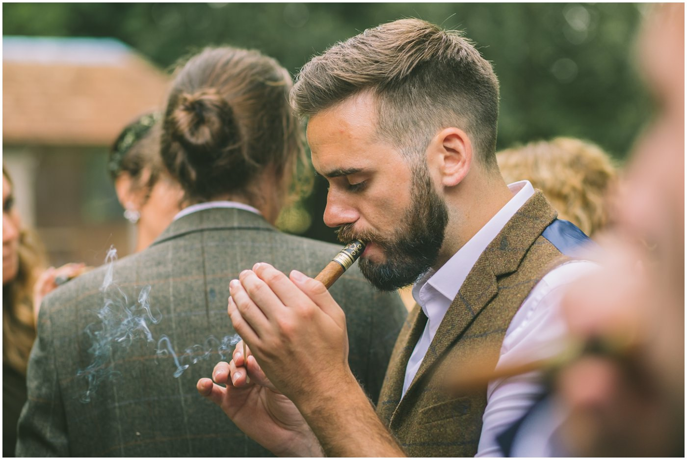 best man lights a cigar