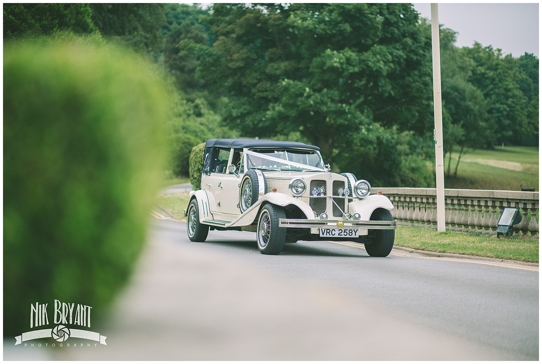 Bridal car arrives at Shrigley Hall Hotel