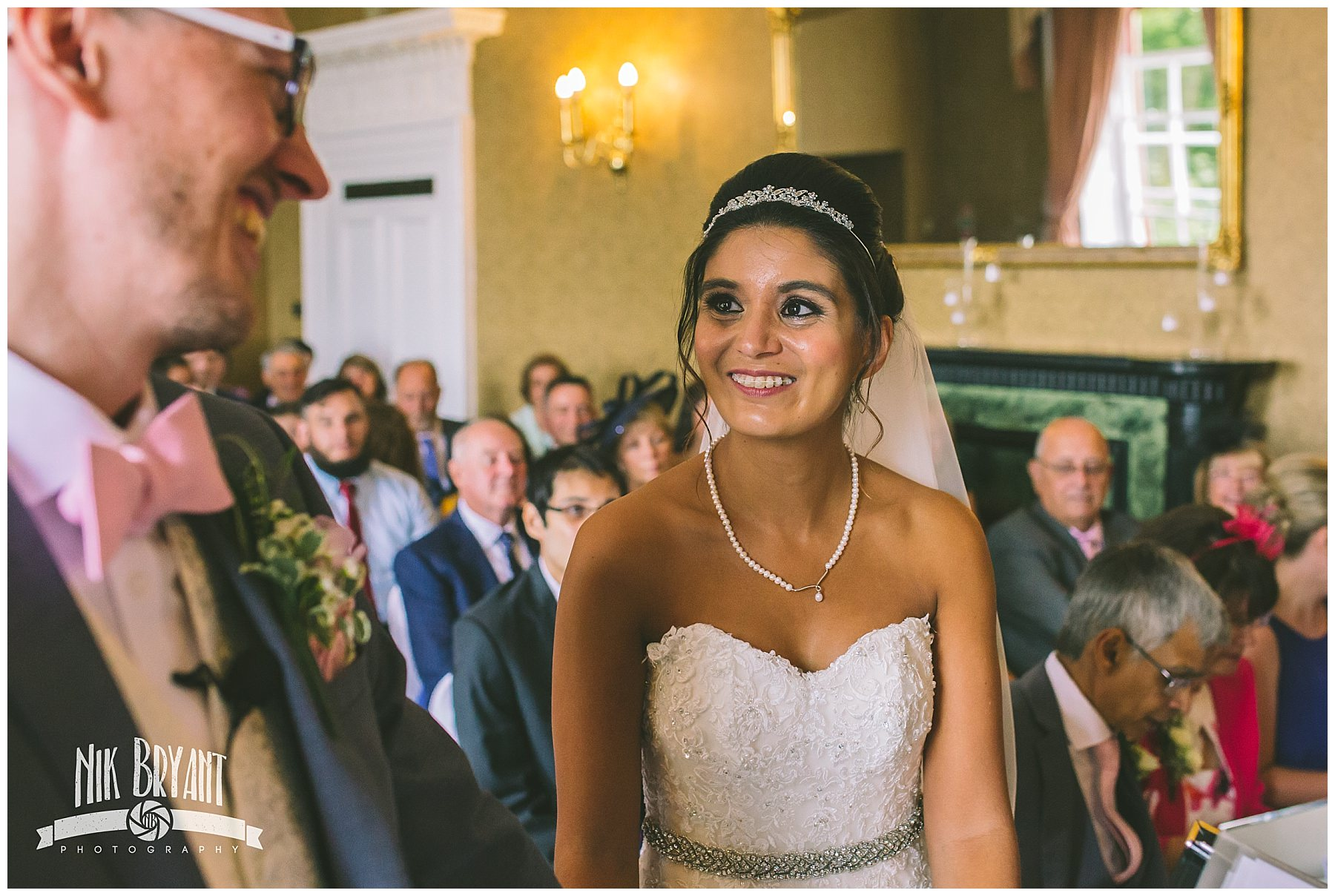 Bride smiles as she sees her groom for the first time