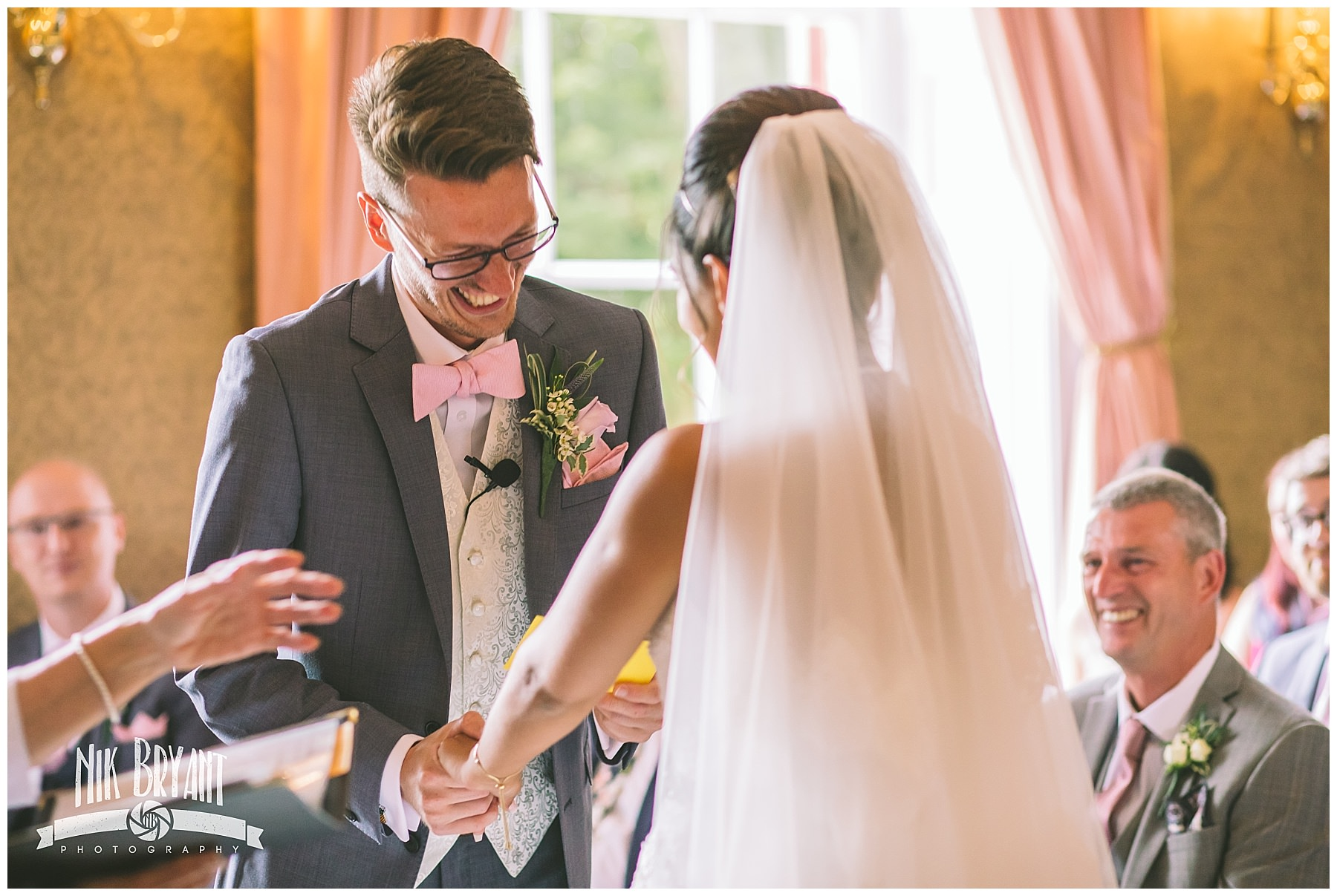 groom laughs during shrigley hall wedding