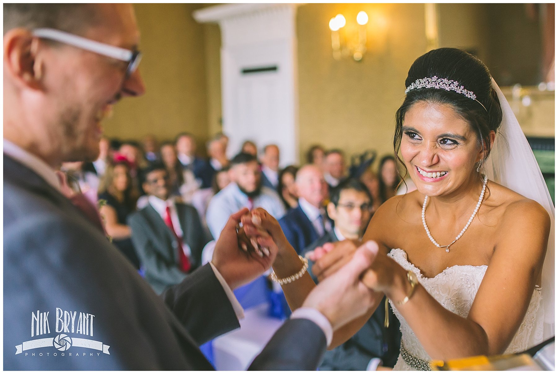 Bride smiles and laughs during shrigley hall wedding