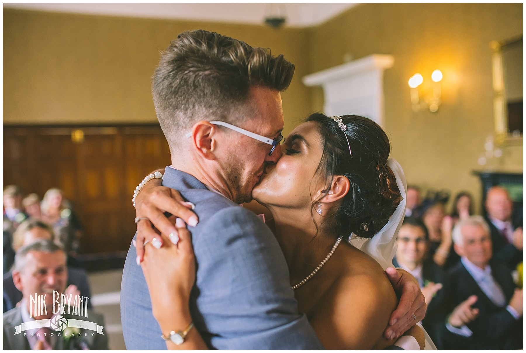 Bride and grooms first kiss at shrigley hall