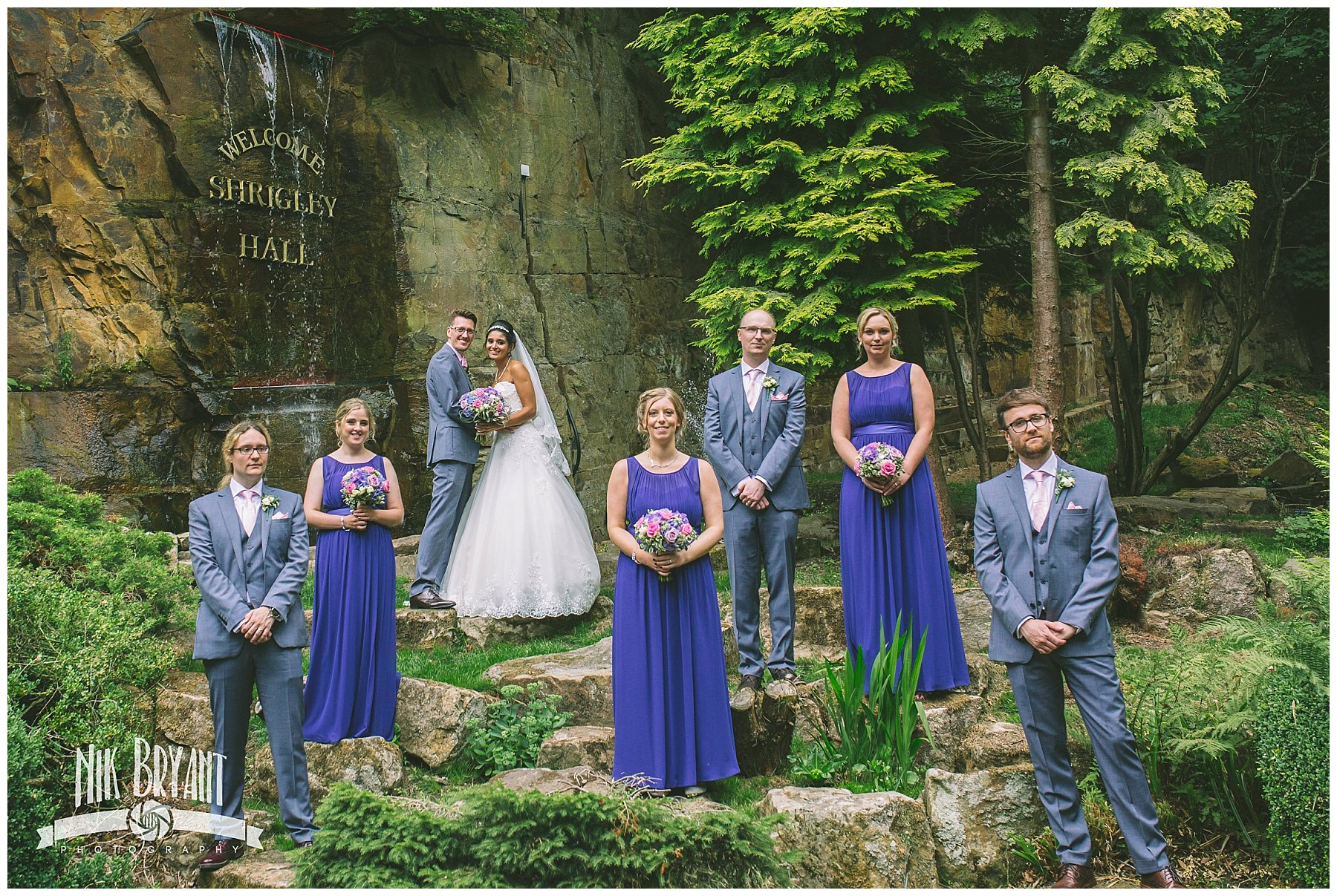 Bridal party at the fountain at shrigley hall