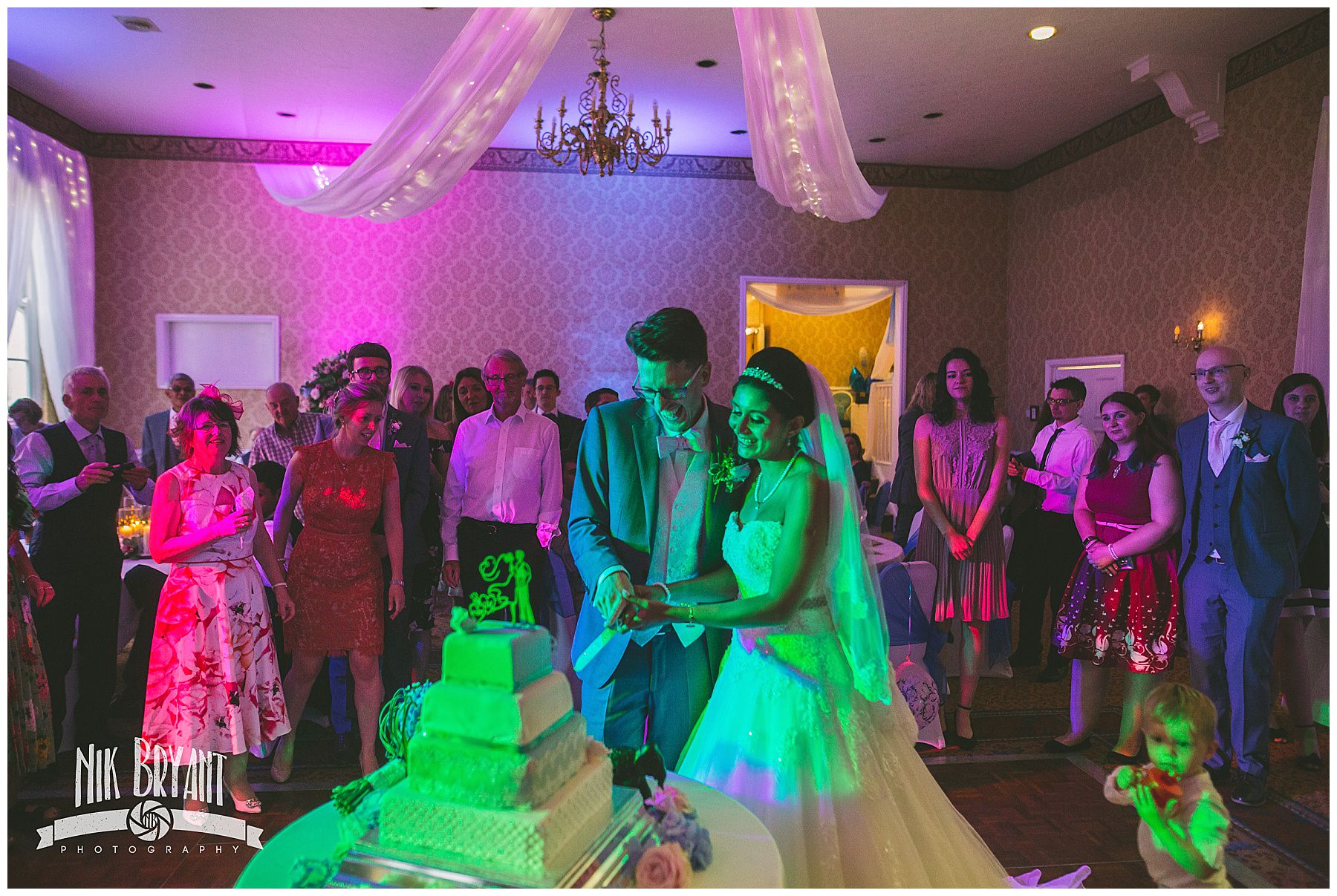 Bride and Groom cut the cake at shrigley hall