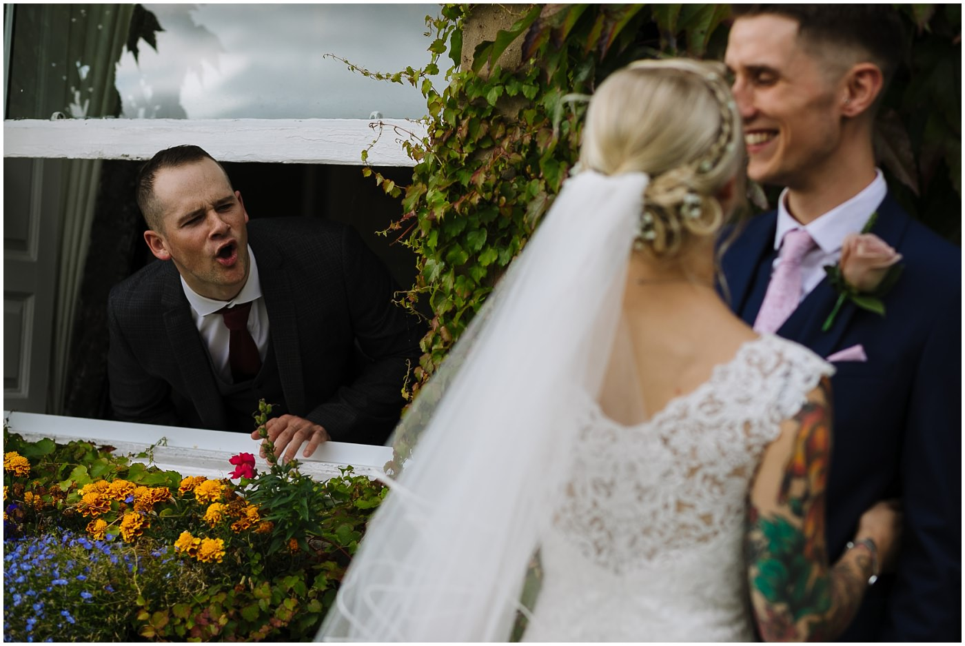 guest heckles bride and groom during portrait session