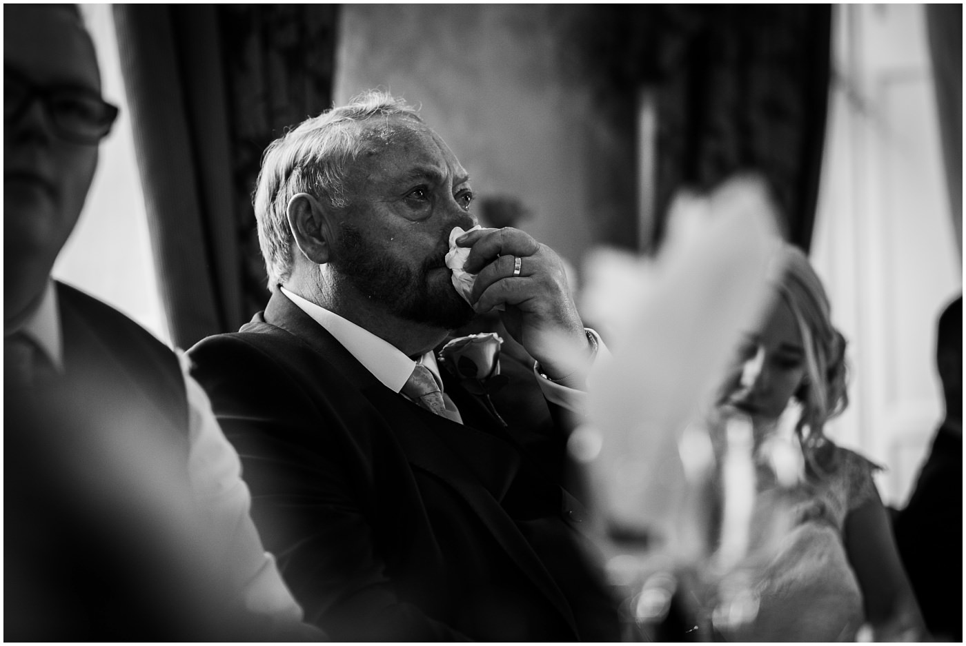 Father of the groom sheds a tear as his son gives a speech at Waterton Park