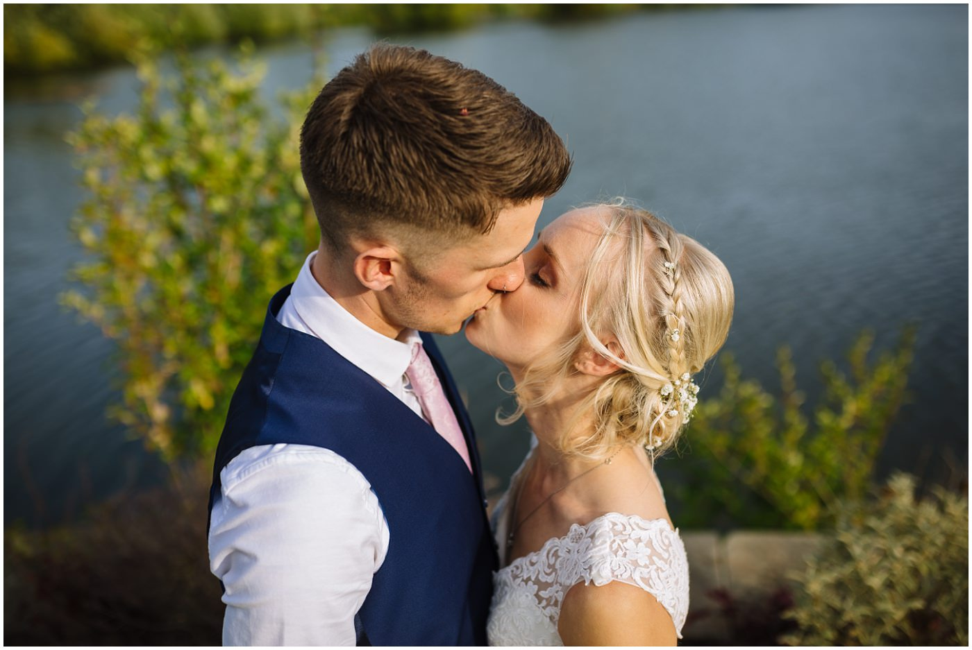 bride and groom kiss at waterton park