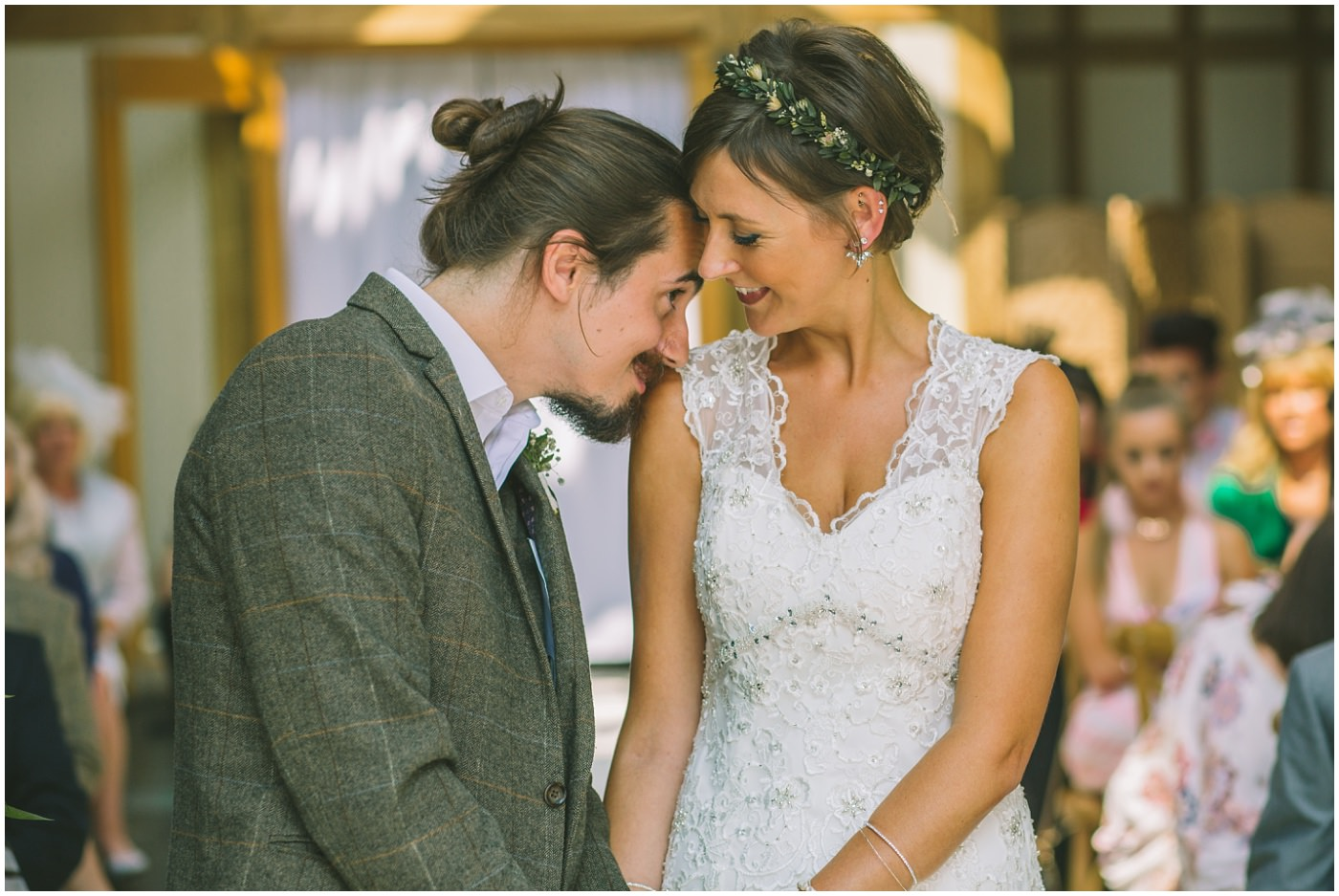 bbride and groom share a moment mid ceremony at The oak Tree of Peover
