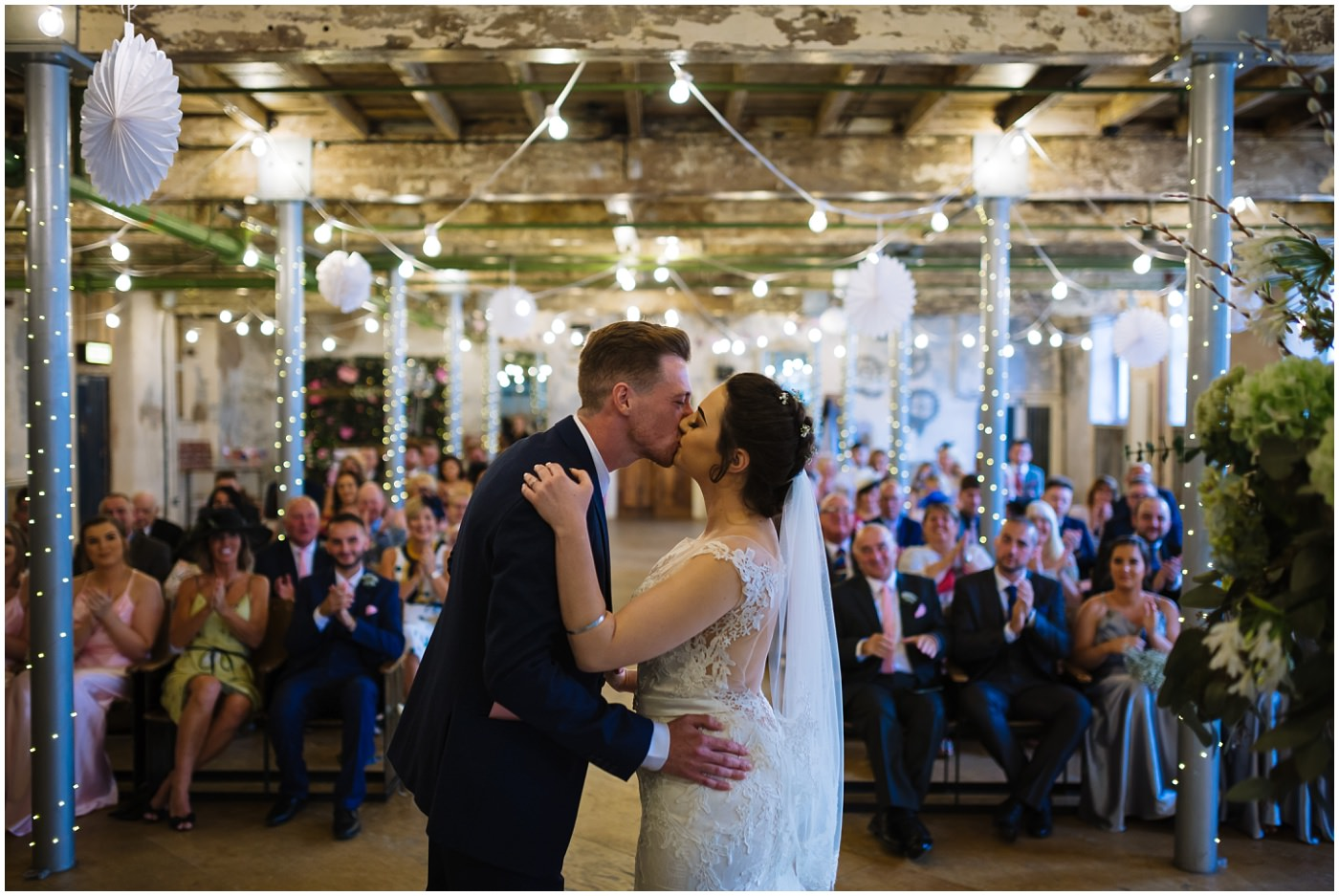 bride and groom first kiss at holmes mill wedding