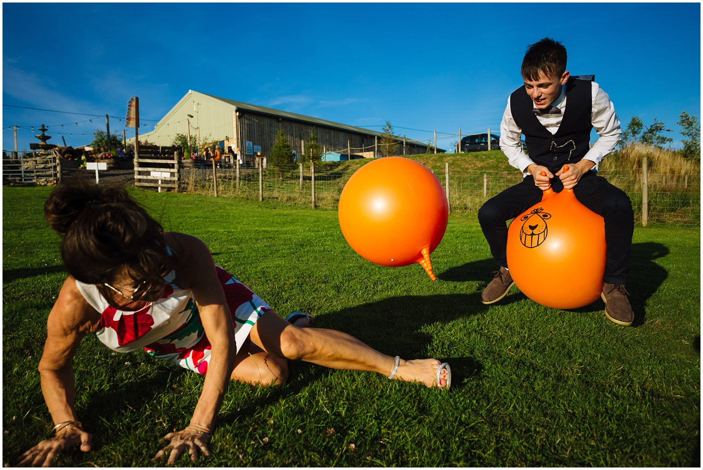 wedding guest falls off space hopper at summer wedding