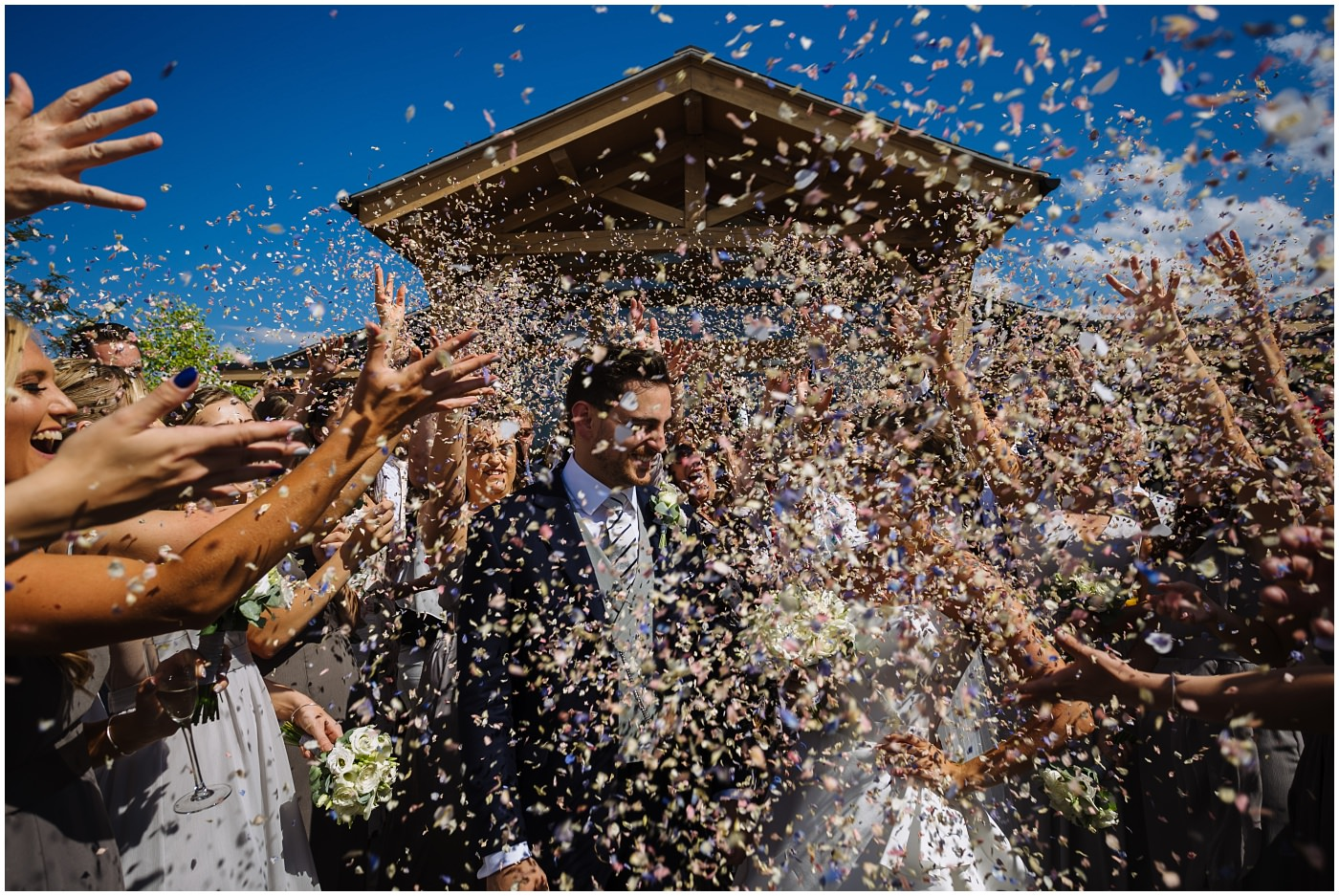Confetti clouds the bride and groom at pryors hayes