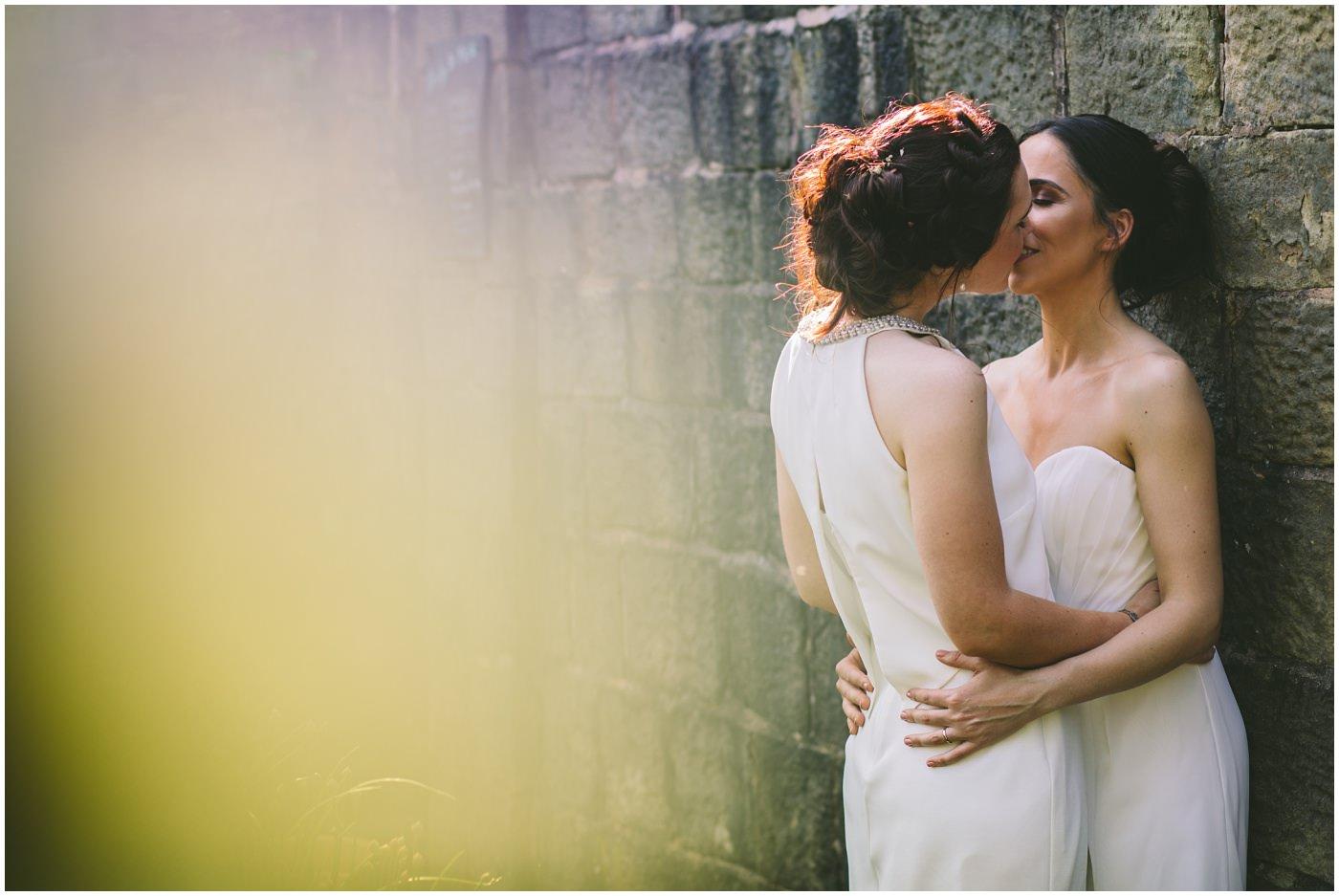 Same sex couple share a kiss on their wedding day