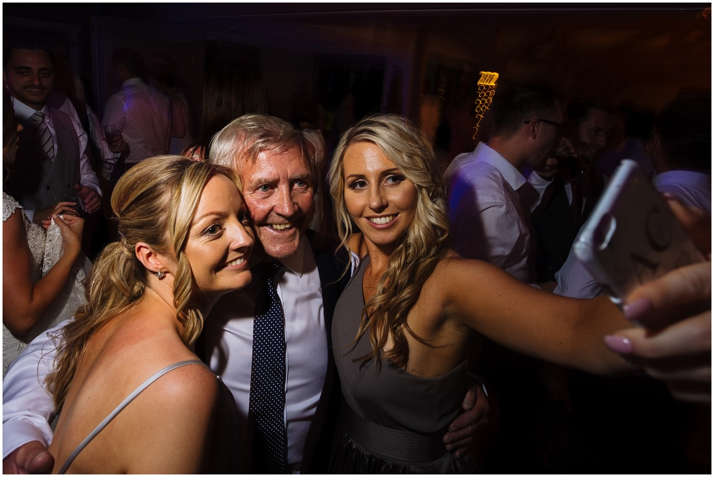 Two bridesmaids get a selfie with father of the bride at pryors hayes