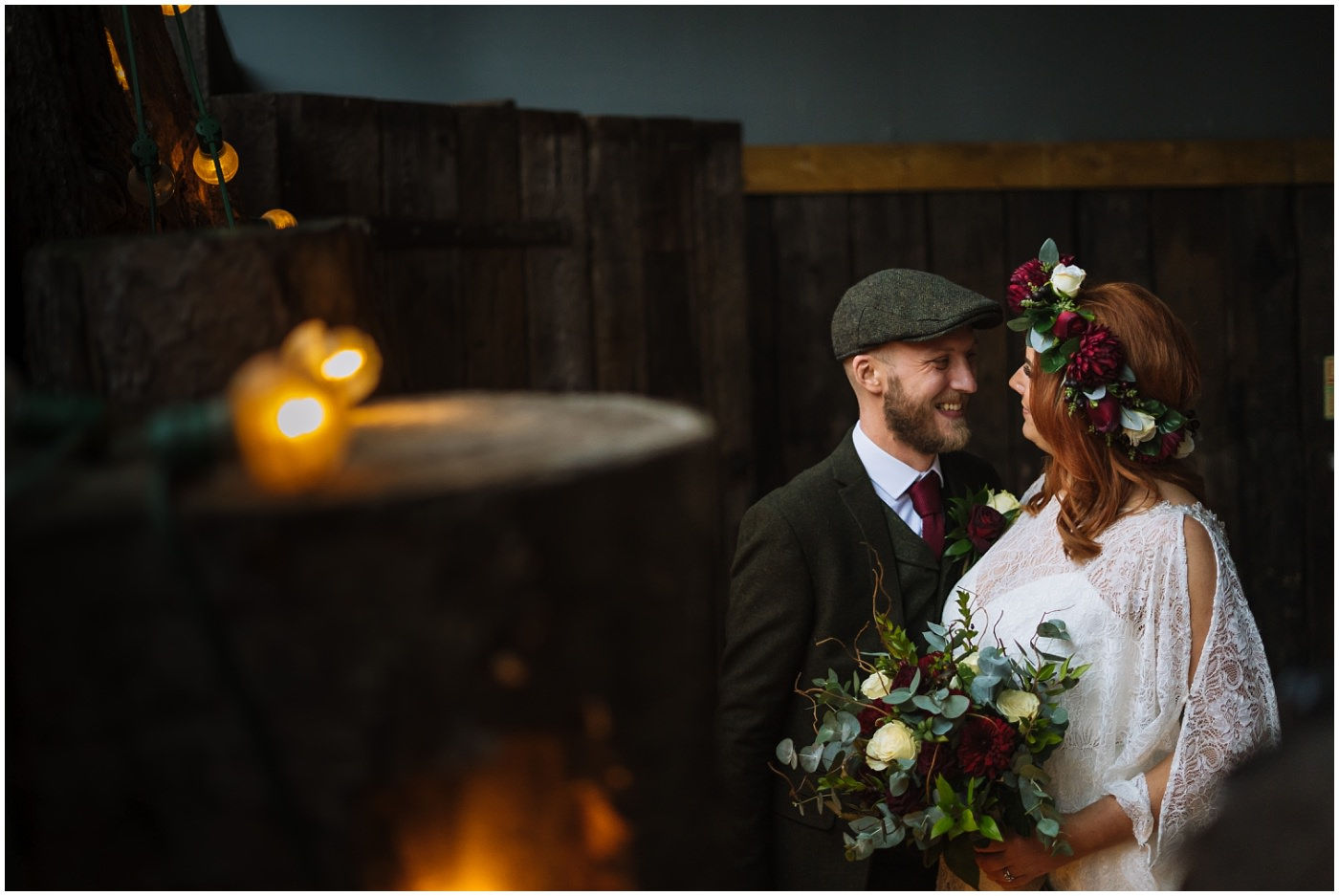 newly married couple in the barn at Owen House Wedding Barn