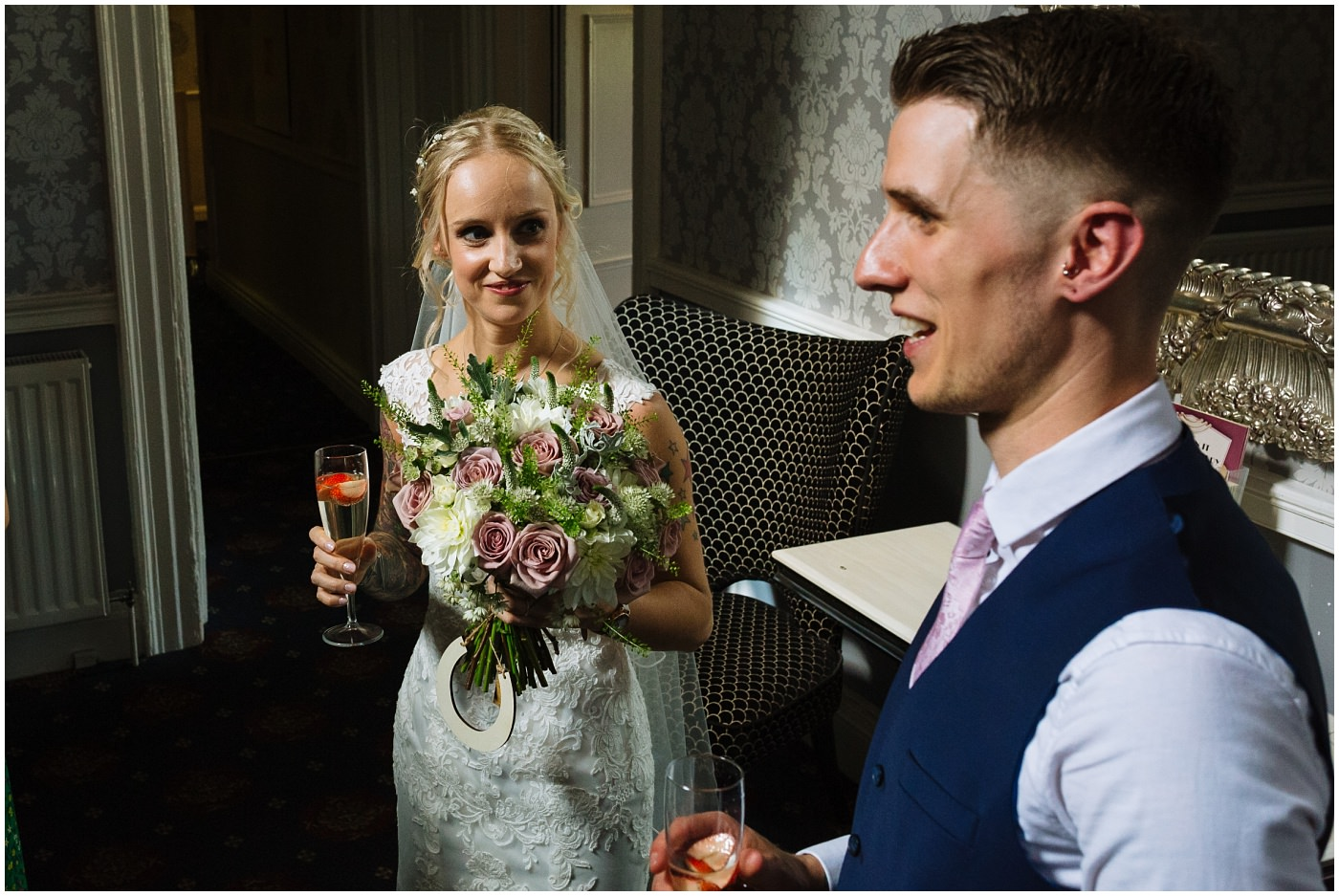 bride looks at groom during drinks reception