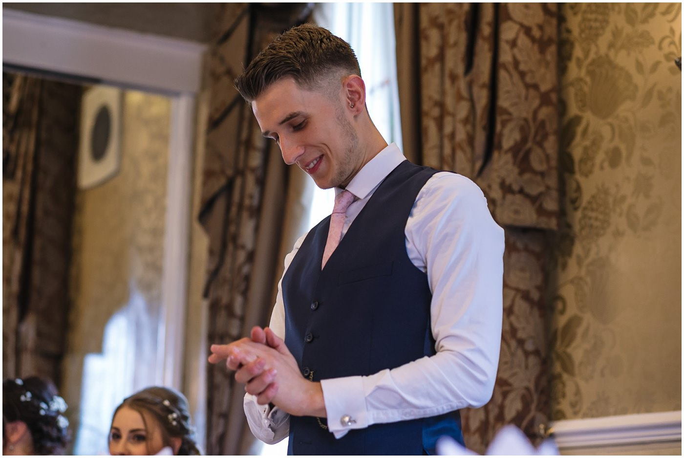 groom nervously gives his wedding speech