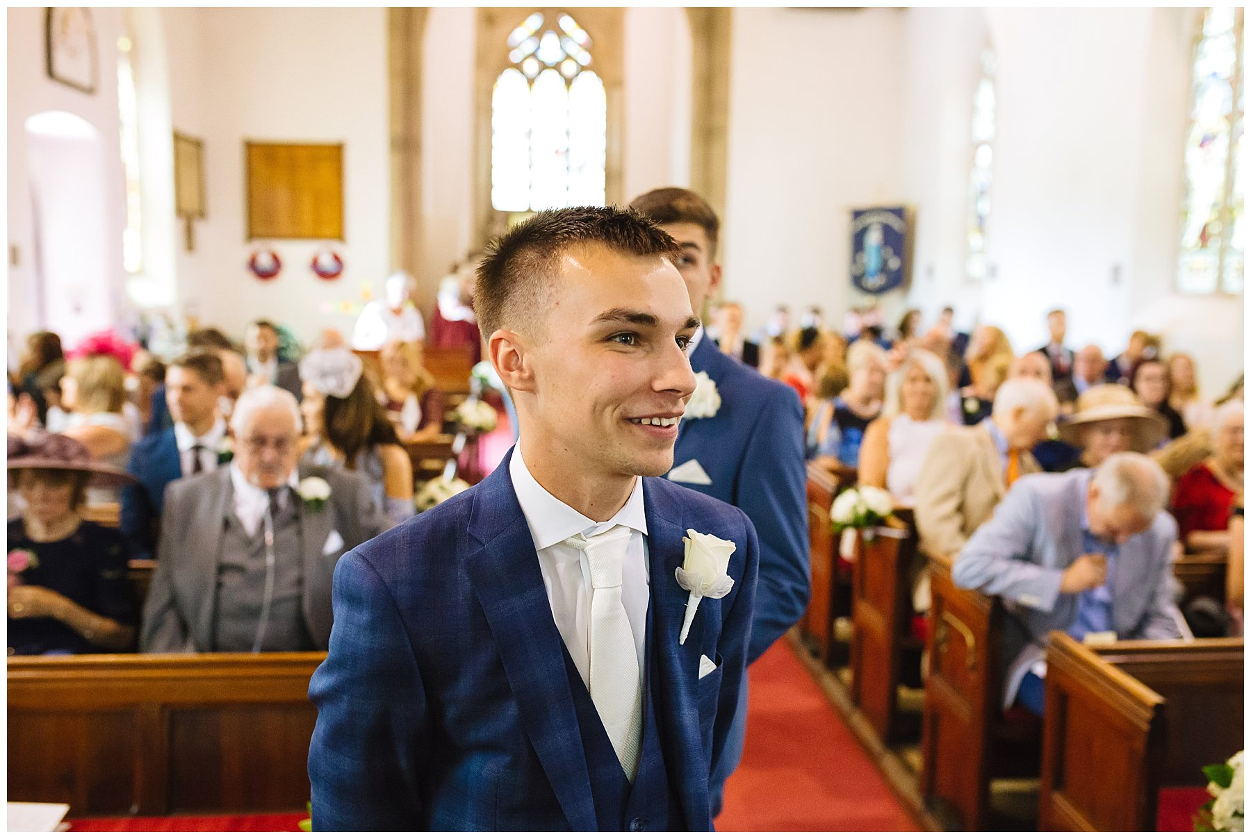 groom waiting nervously at church