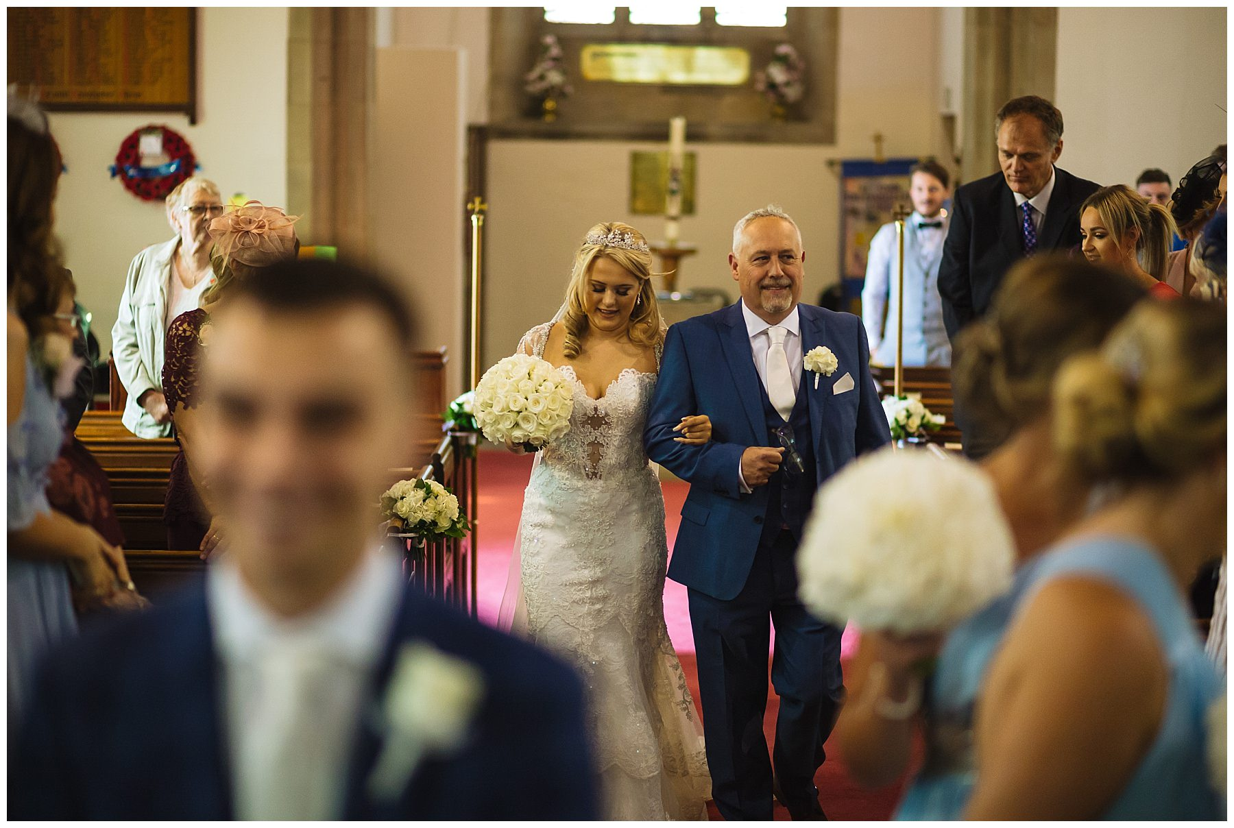 bride walks down isle with dad