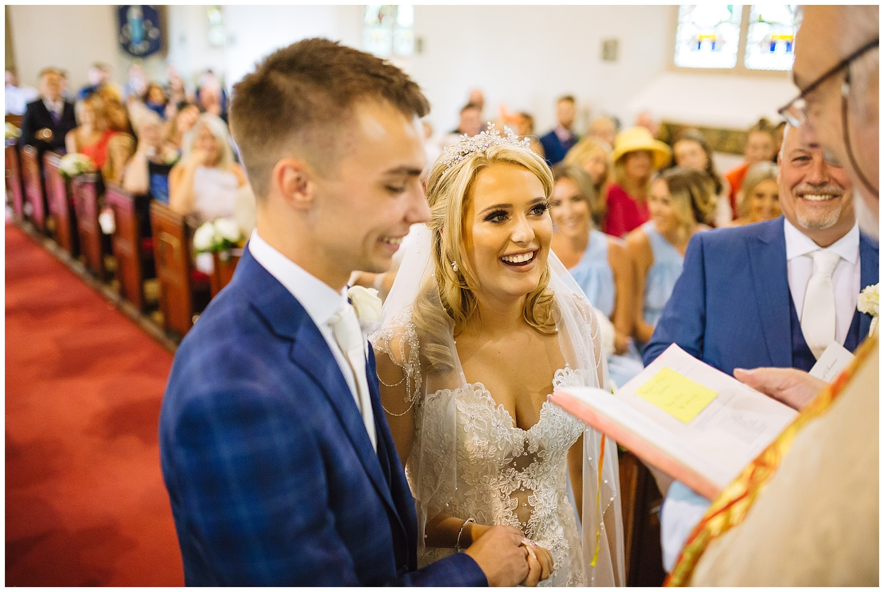 bride and groom smile during Ribble valley church wedding