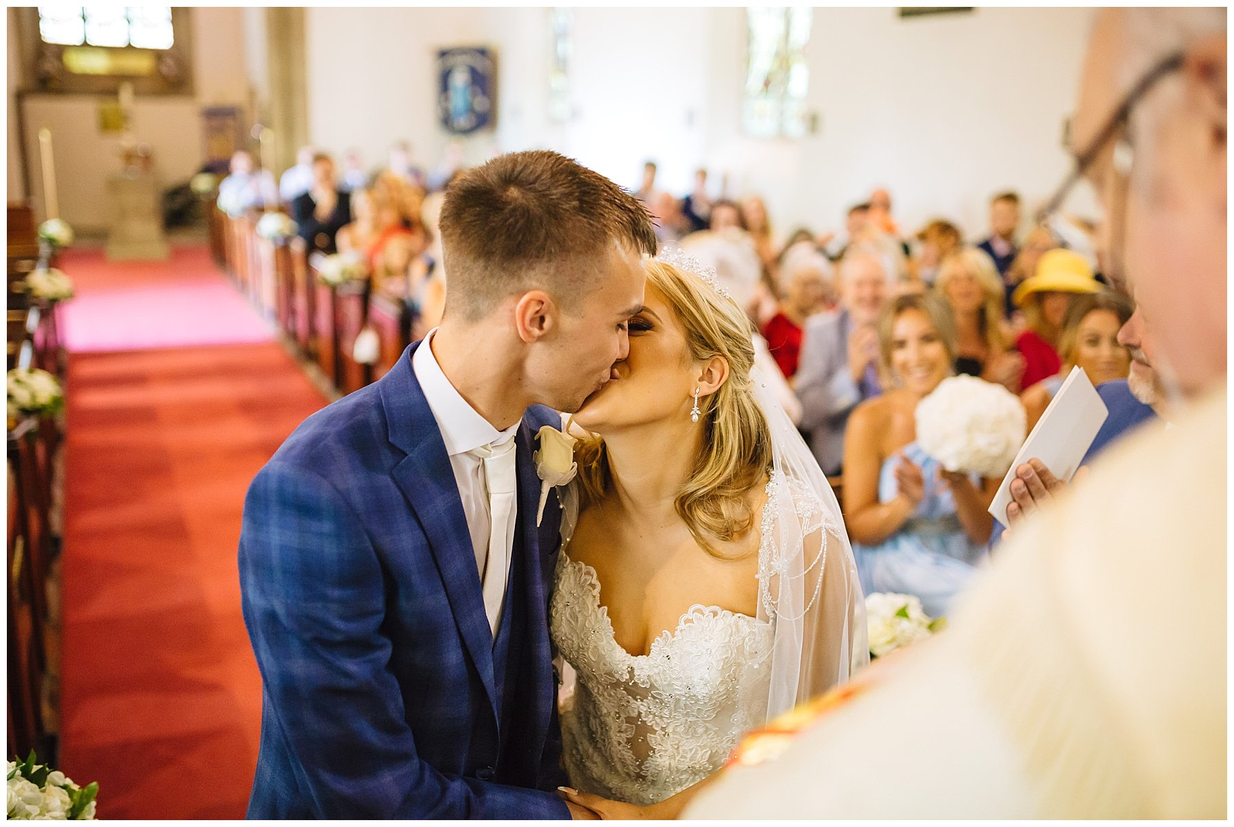 bride and groom kiss at Lancashire wedding ceremony