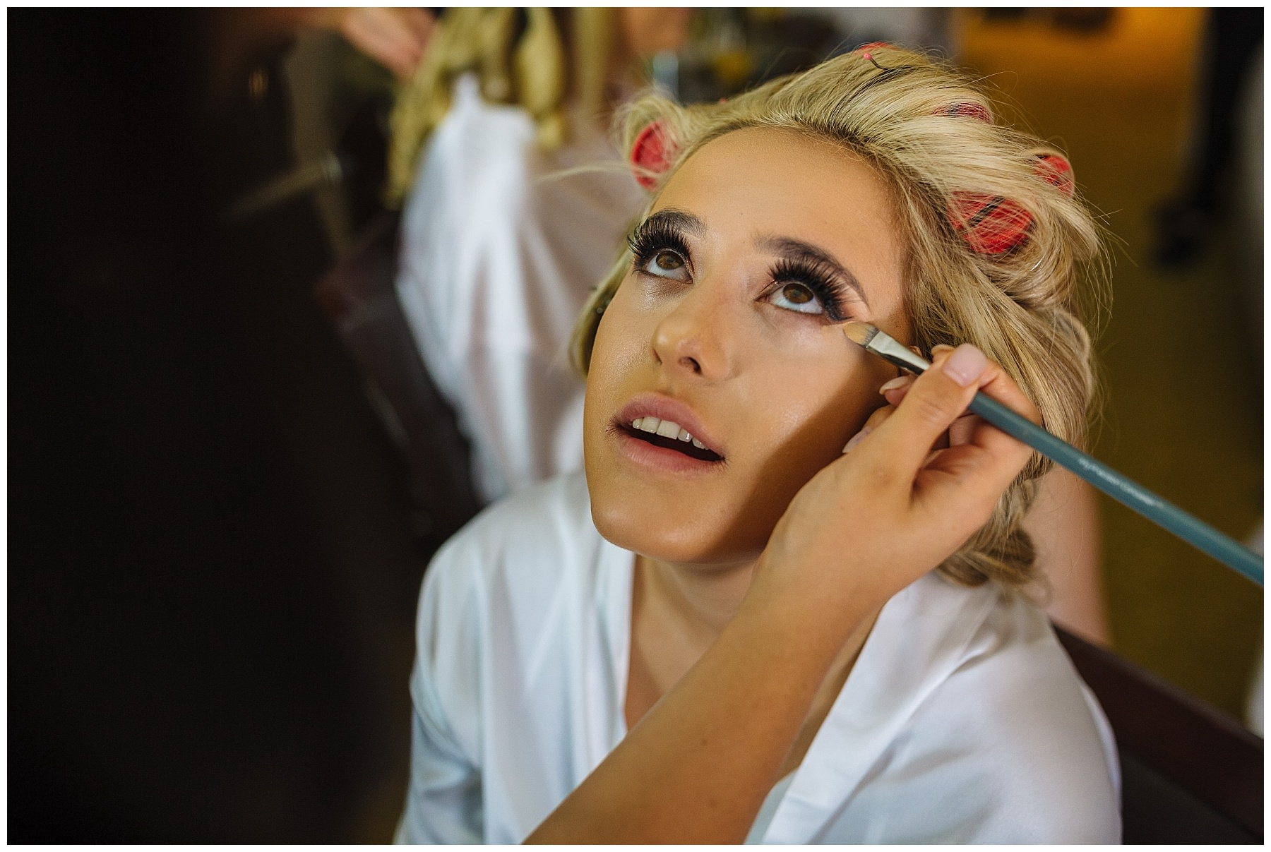 the makeup company working their magic on bartle hall bride