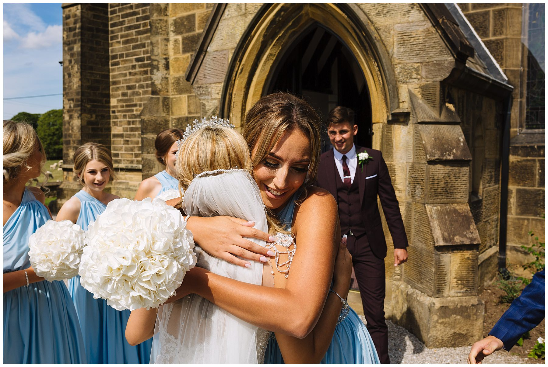 hugs and celebrations with newly weds outside church