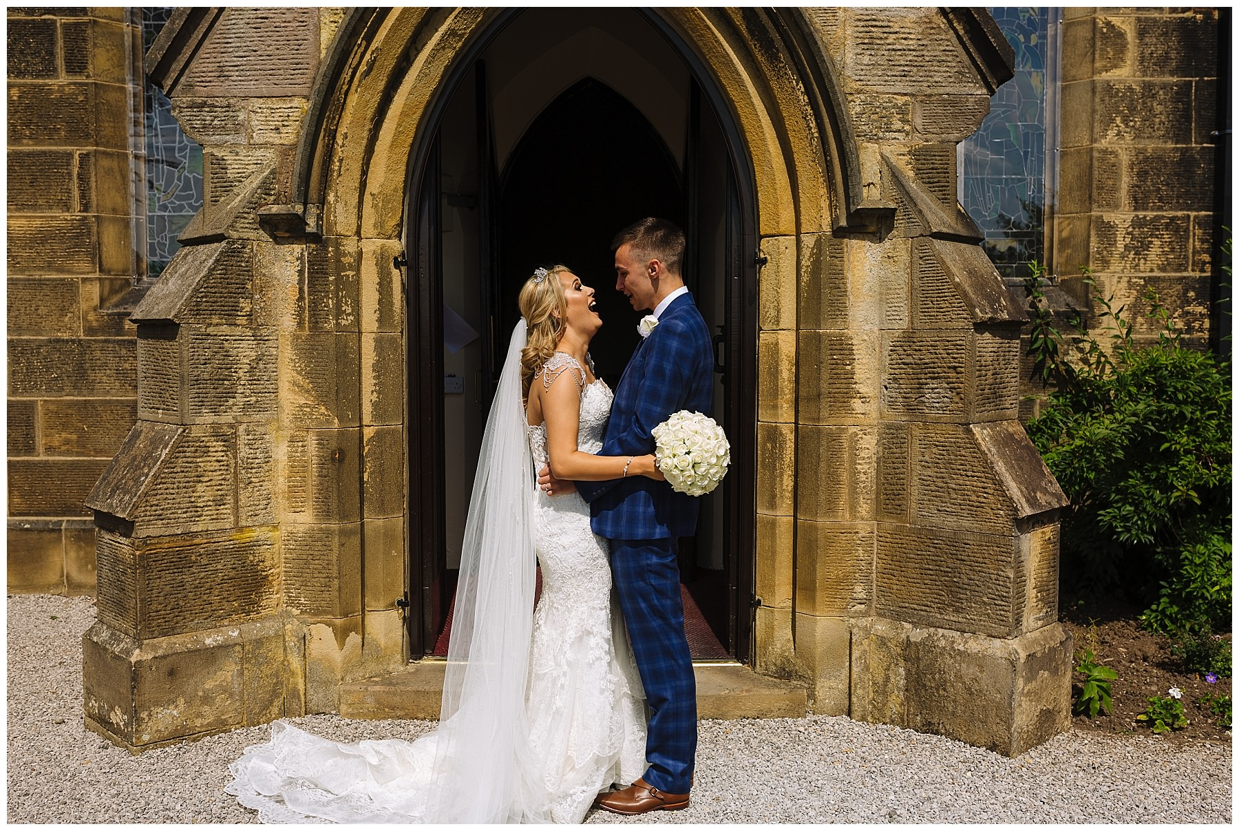 Bride and Groom laugh outside Lancashire Church