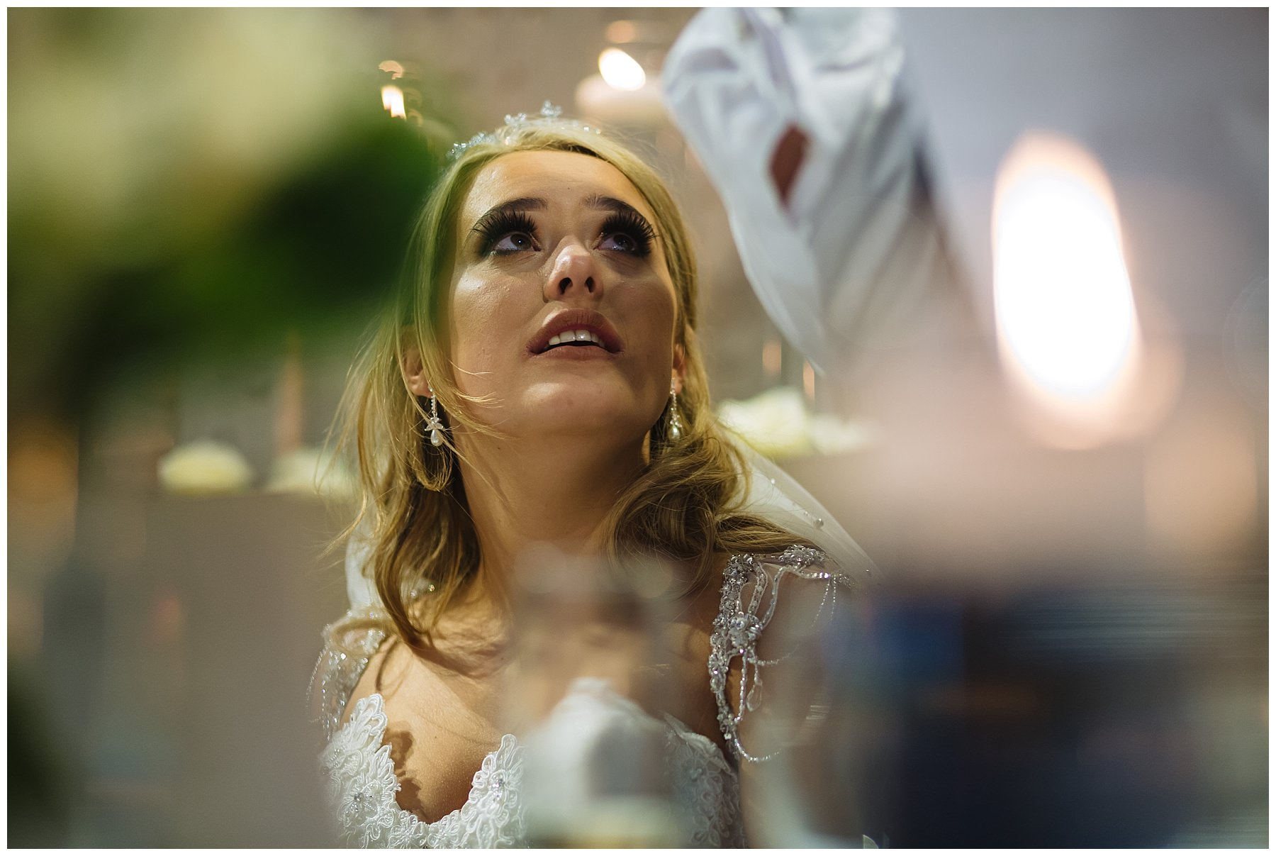 bride looks up at dad during his speech