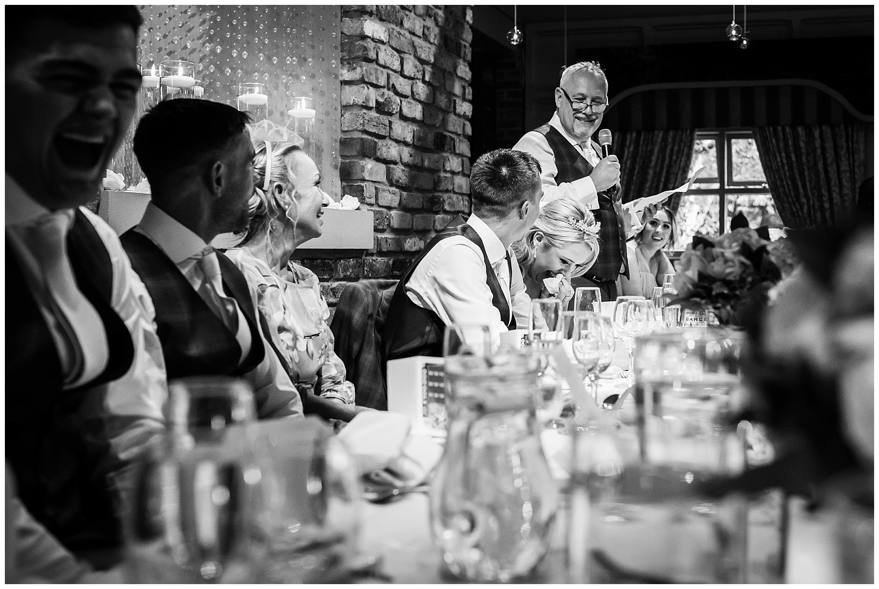 Father of the brides speech in black and white at Bartle Hall