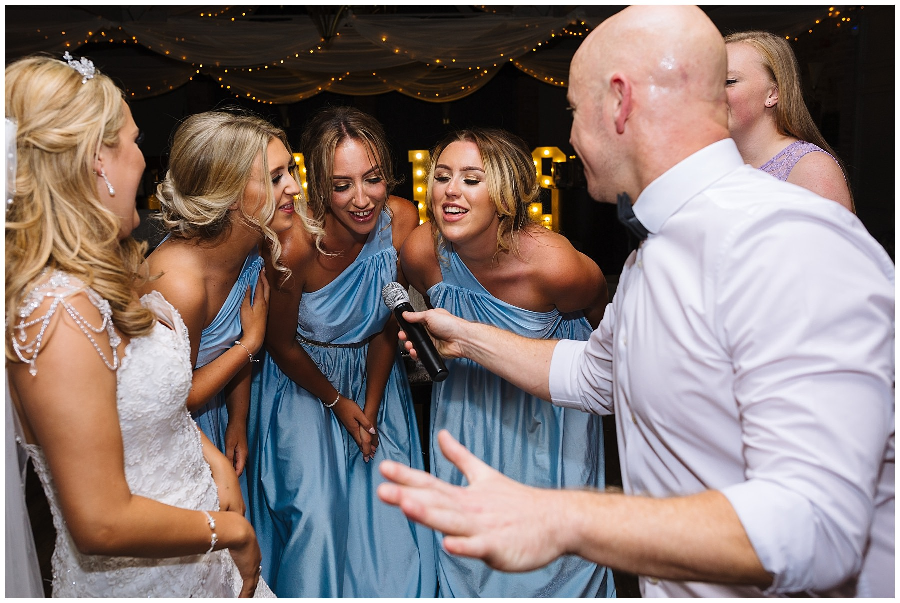 Bridal party singing with Wayne Farrow