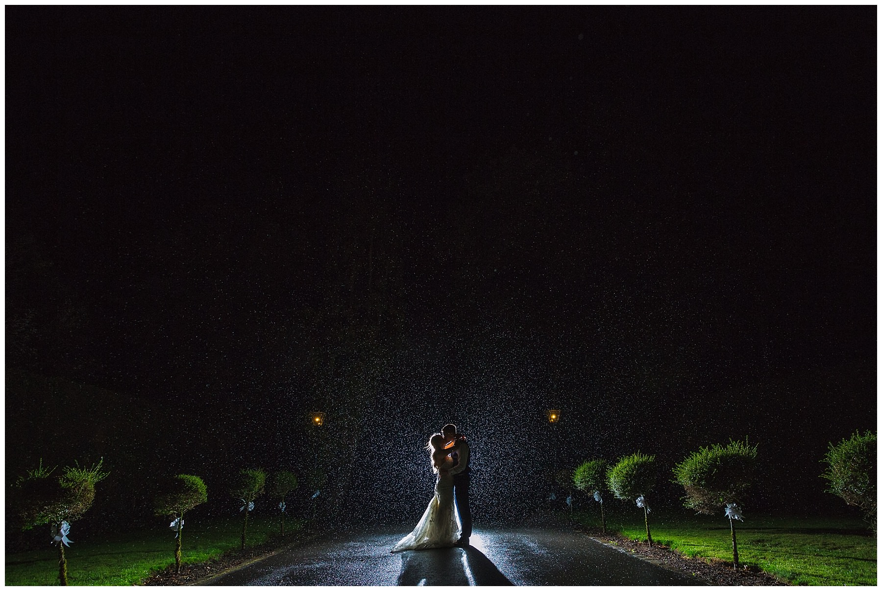 Couple in the rain for night portraits at Bartle Hall