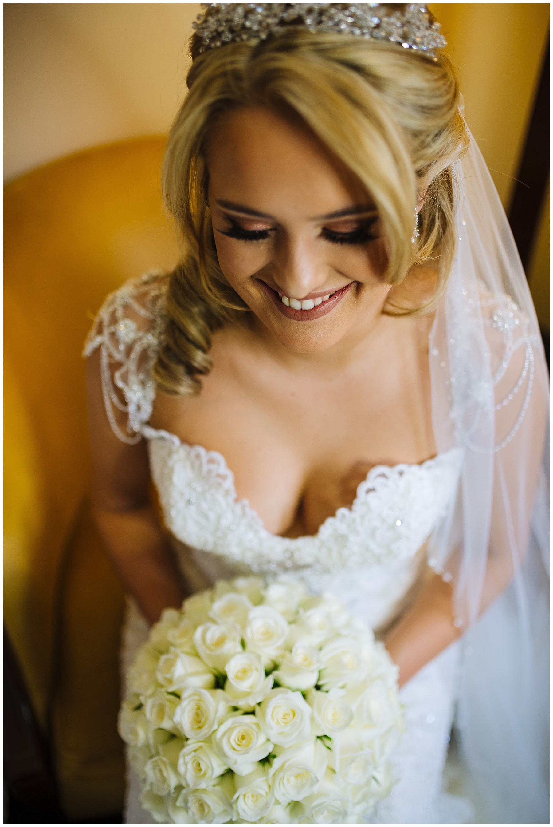 stunning bride smiles for portrait before wedding