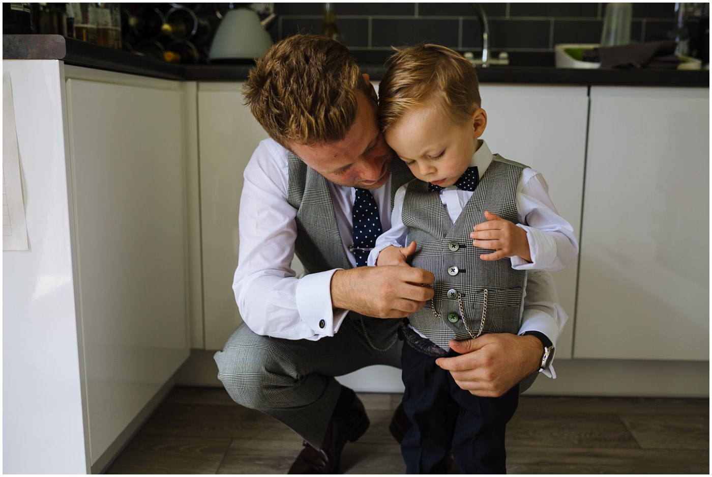 Groom and son in matching whitfied and ward suits
