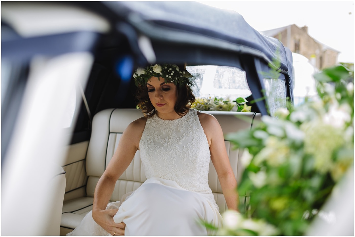 bride arrives at church in wedding car