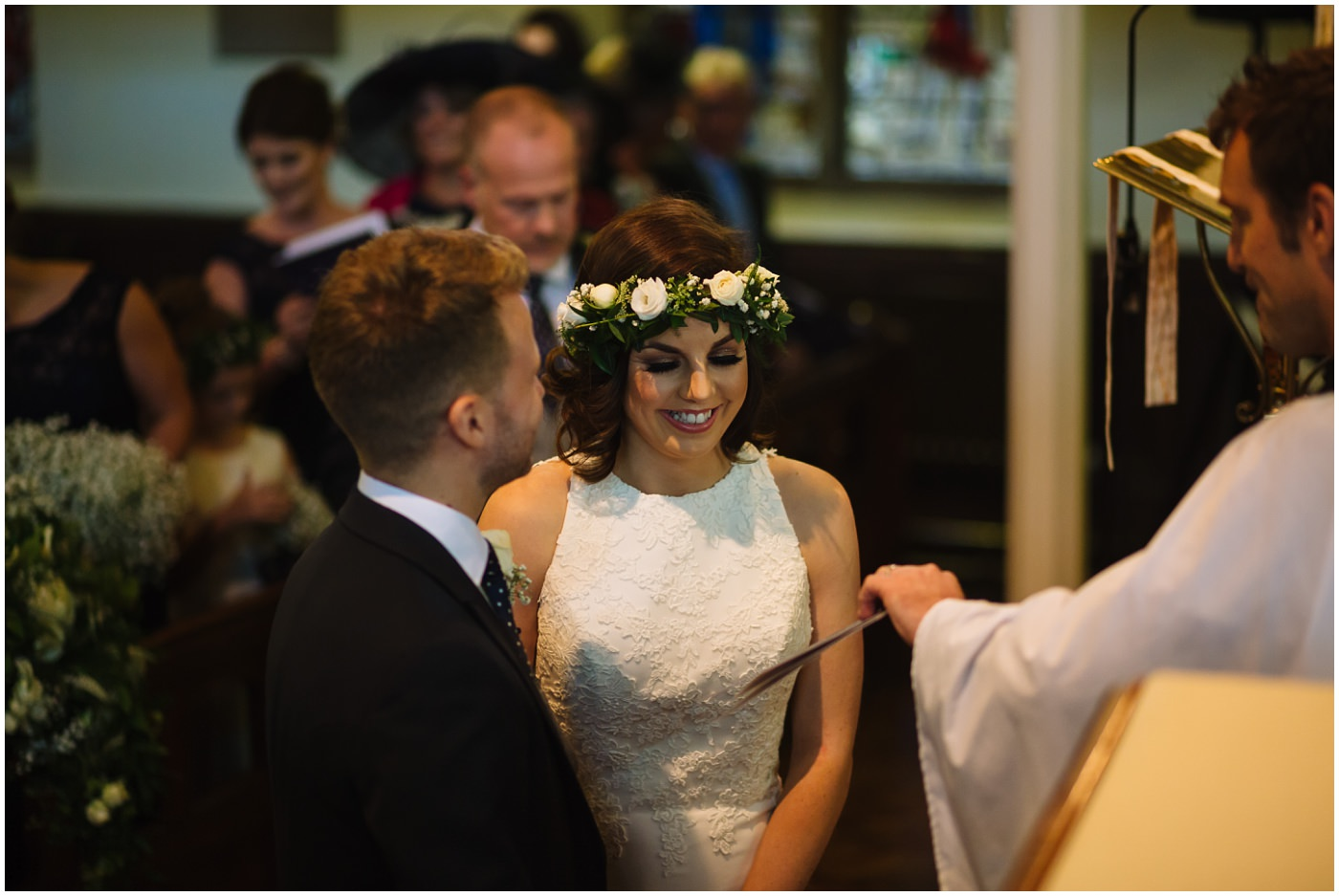 bride smiles during wedding service