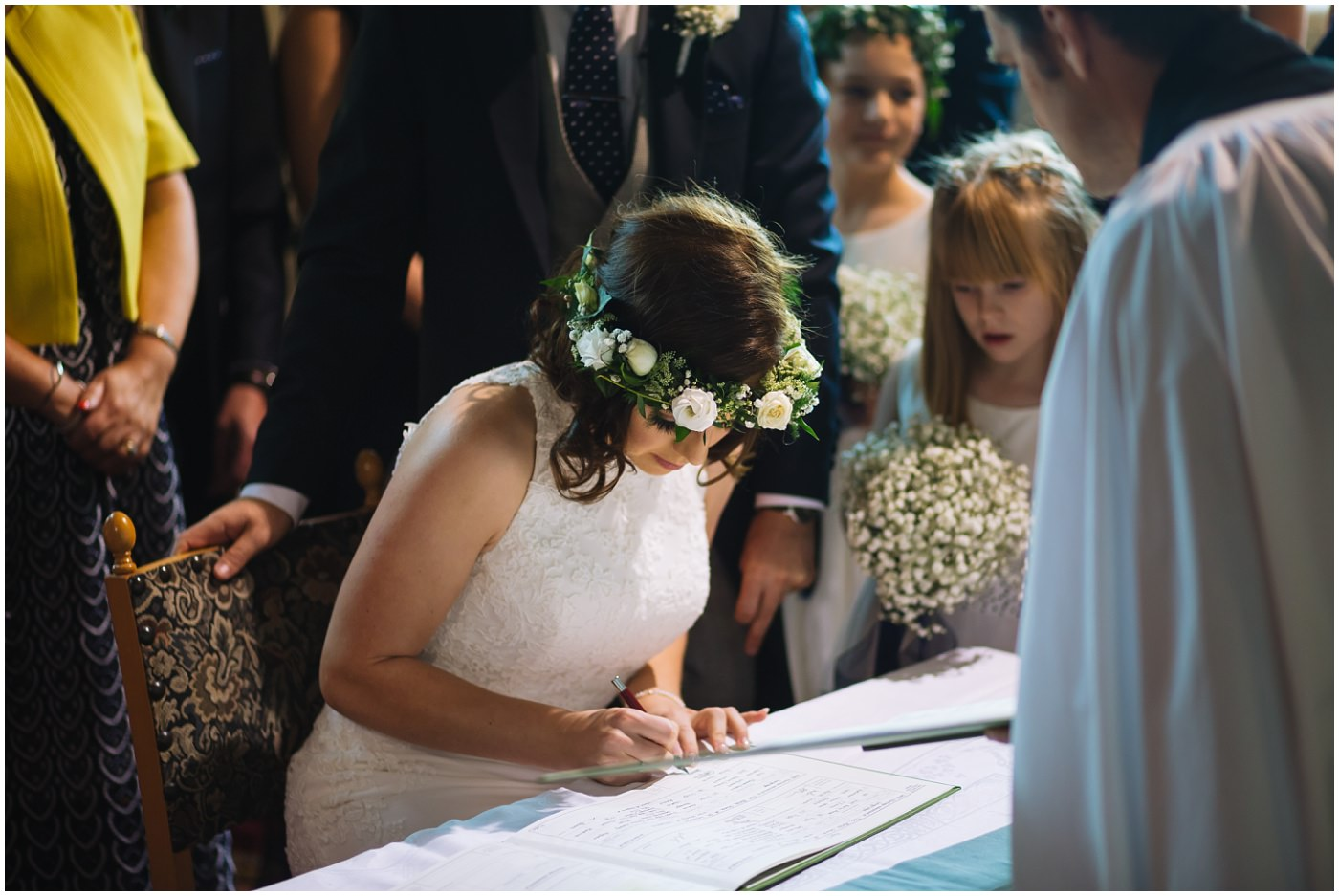 bride signs the wedding register