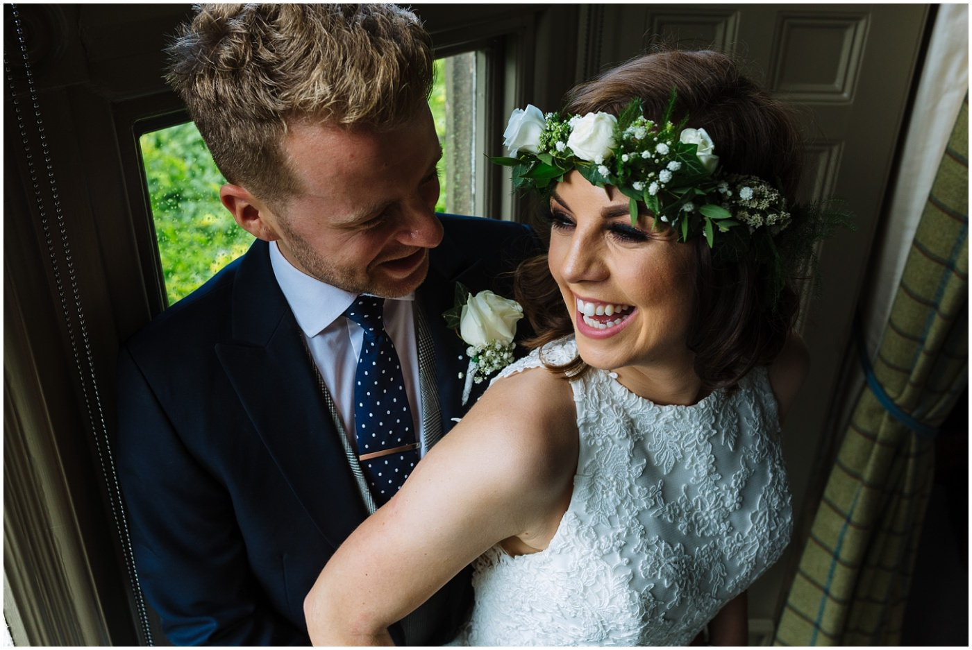 married couple laugh and smile at mitton hall