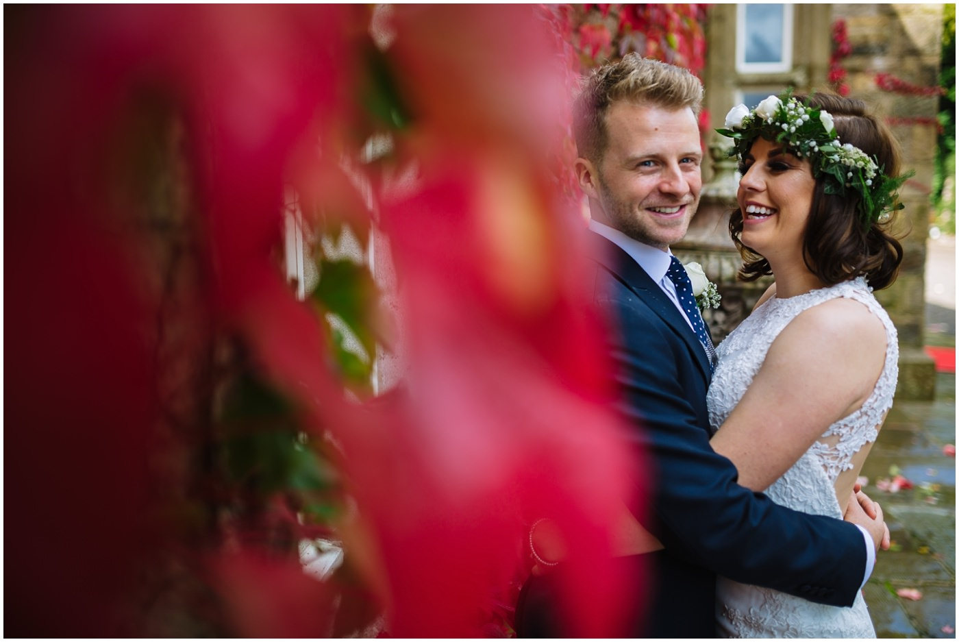 Bride and groom share a moment during portraits at Mitton Hall