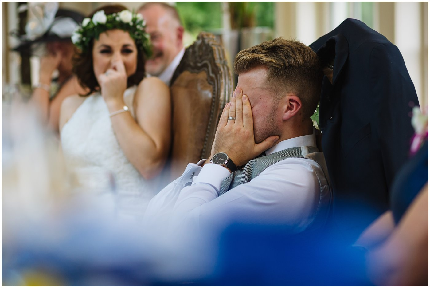 groom is embarrassed by best man