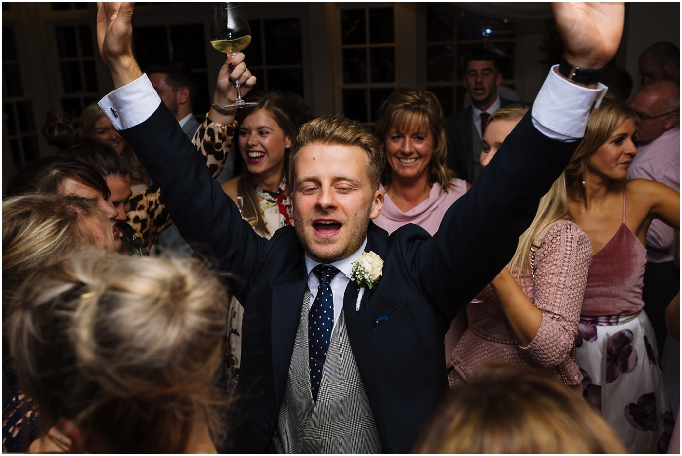 groom on the dancefloor at mitton hall