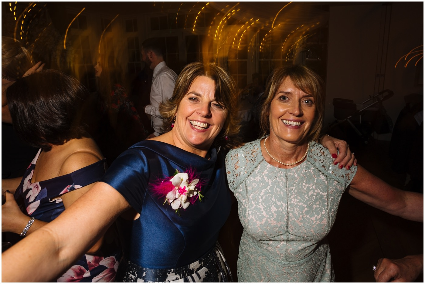 mother of the bride on the dance floor at mitton hall