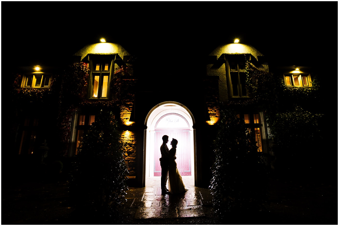 Creative wedding portrait outside Mitton Hall at Night