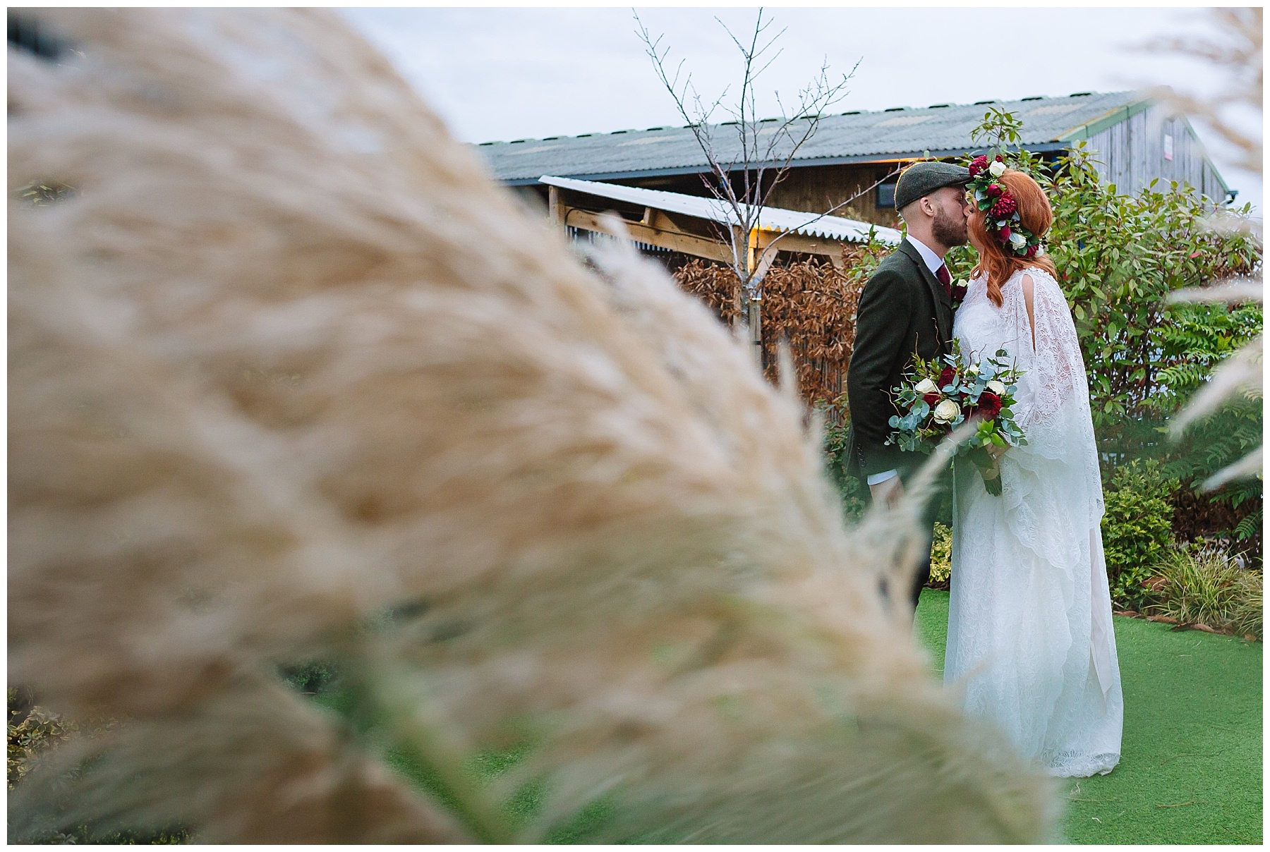 Kissing couple in the pampas grass