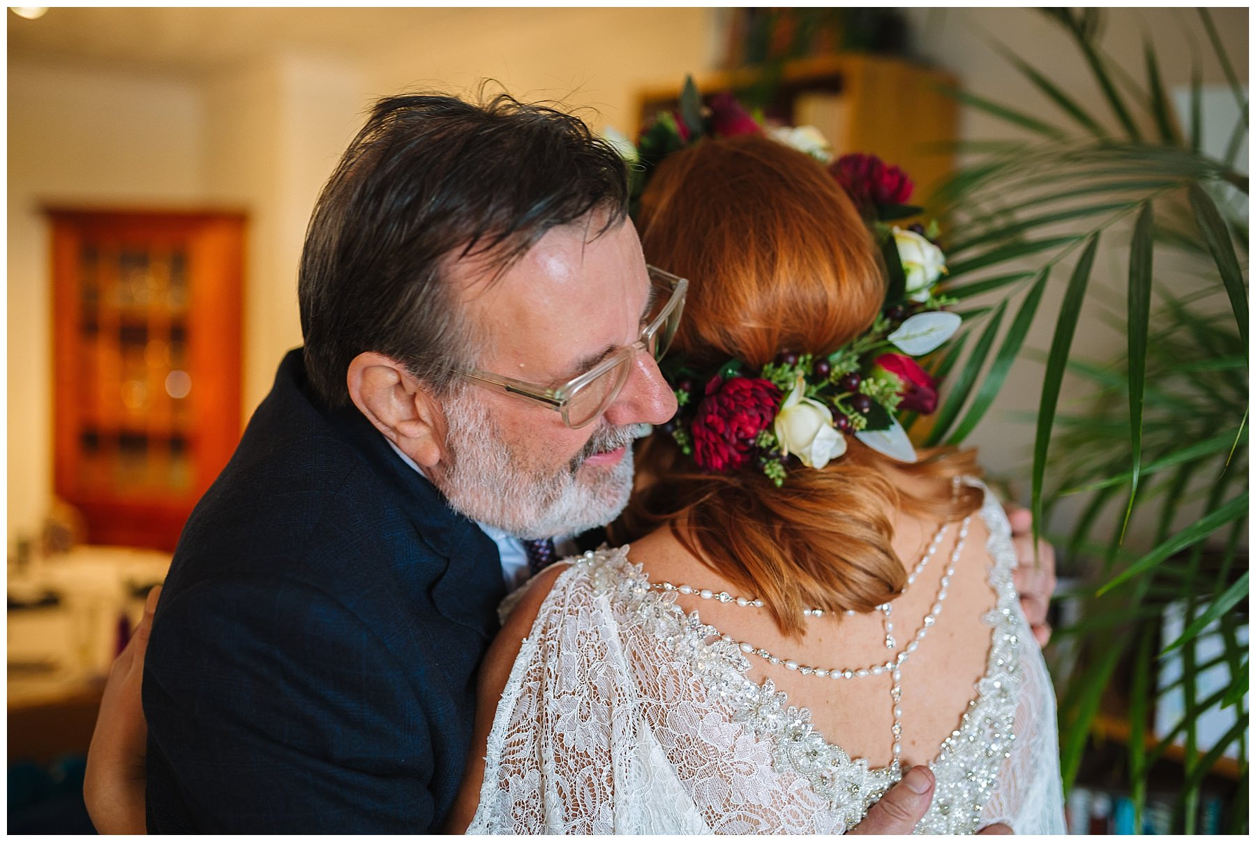 dad and daughter hug on morning of wedding
