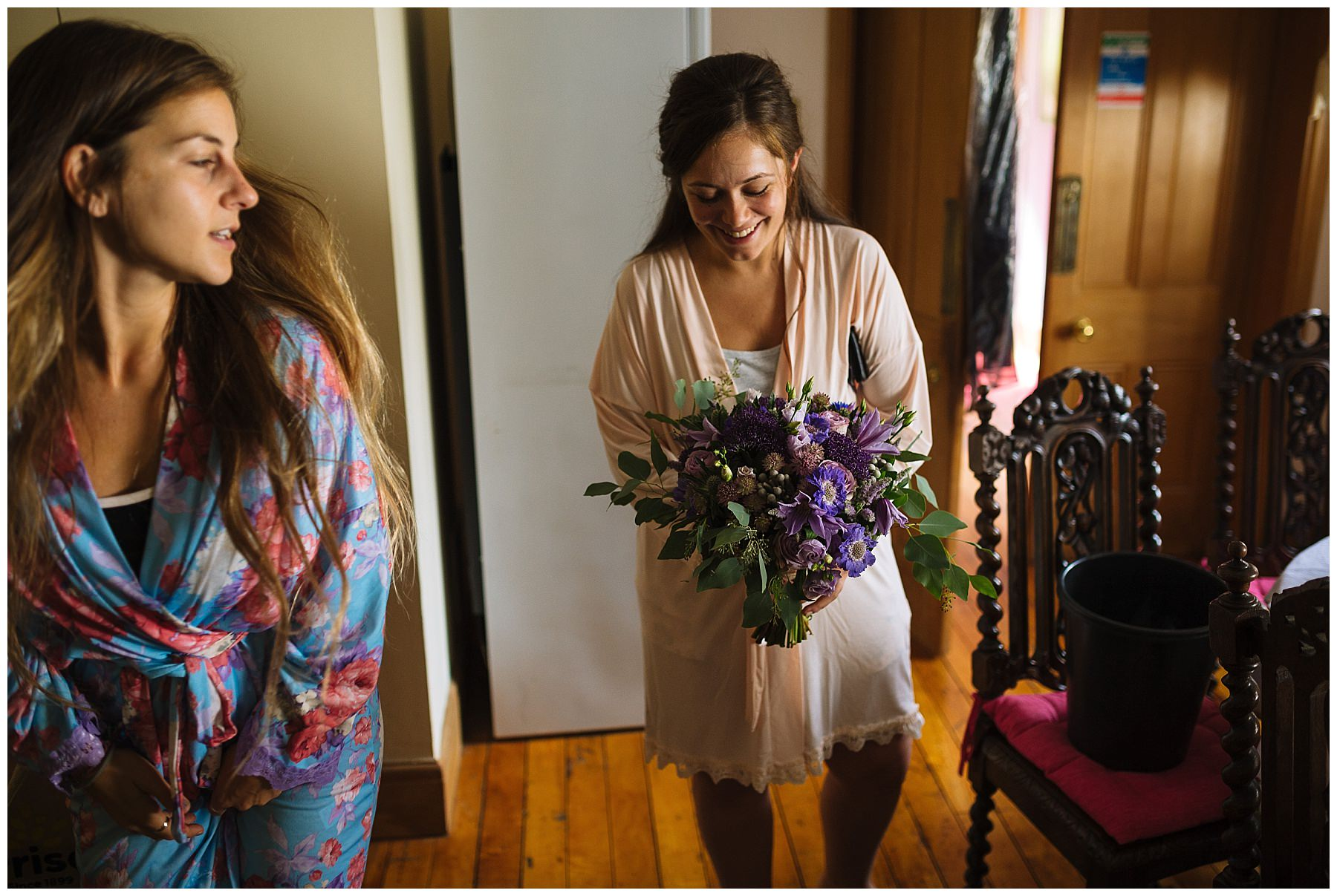 Bride looks at her colourful bouquet