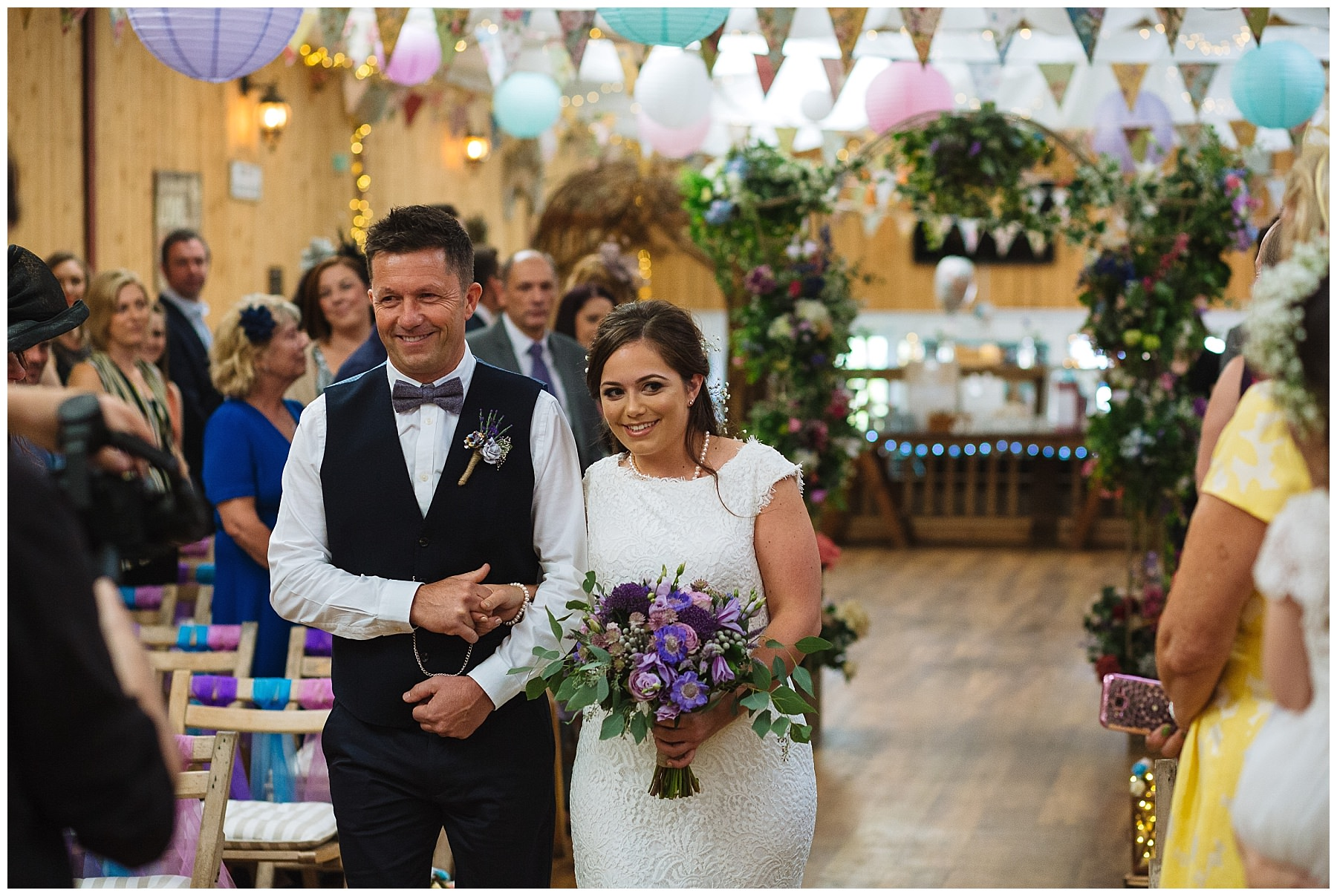 bride and father walk down the isle at the wellbeing farm