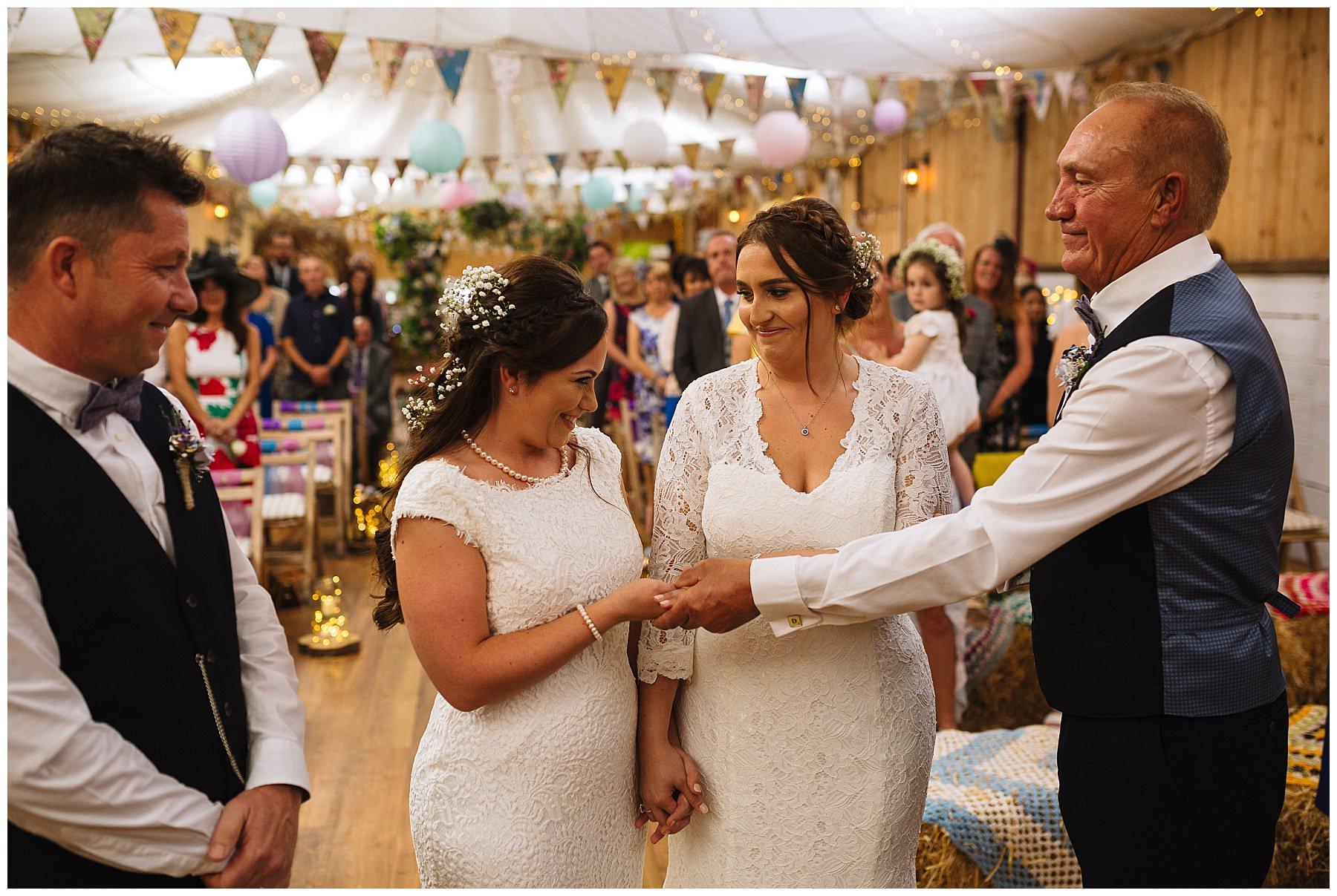 brides giggle during wellbeing farm wedding