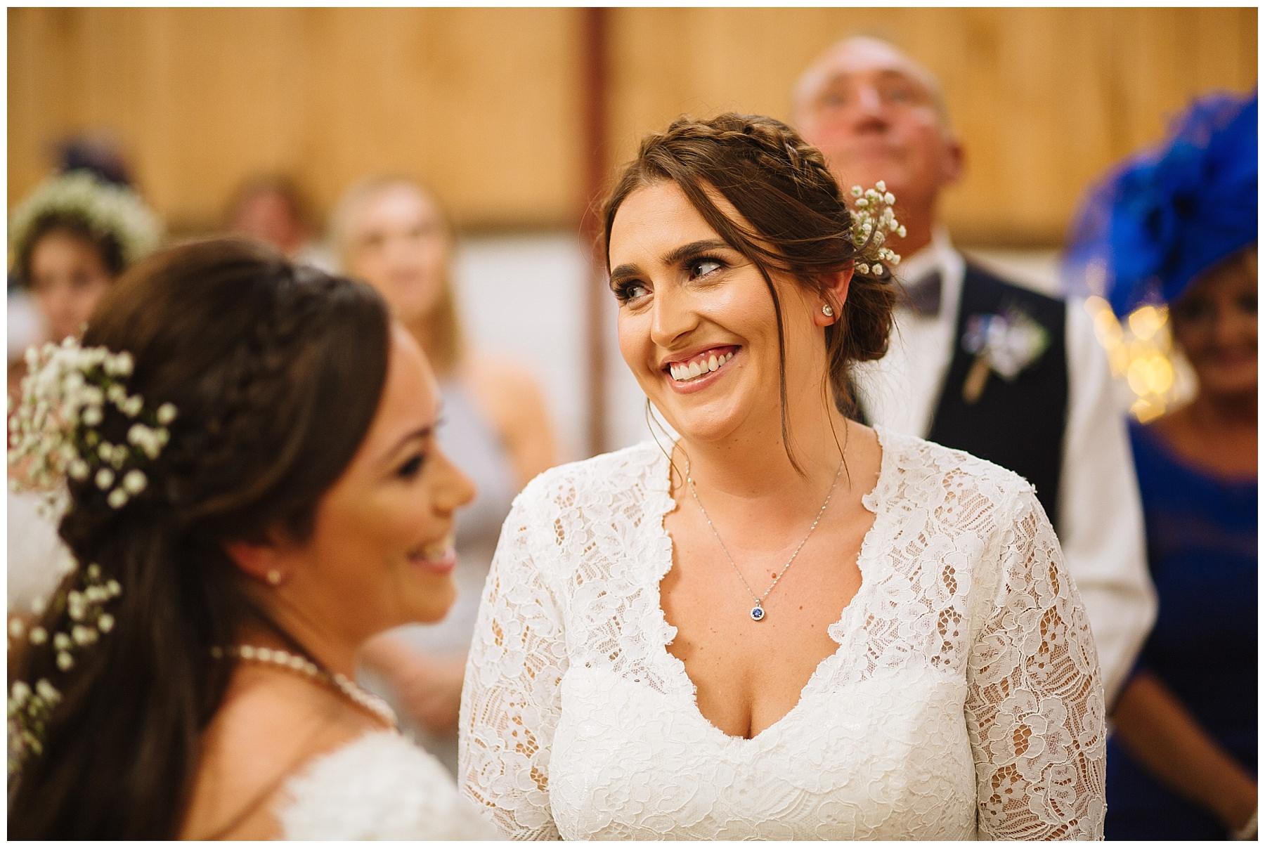 bride smiles during wedding service
