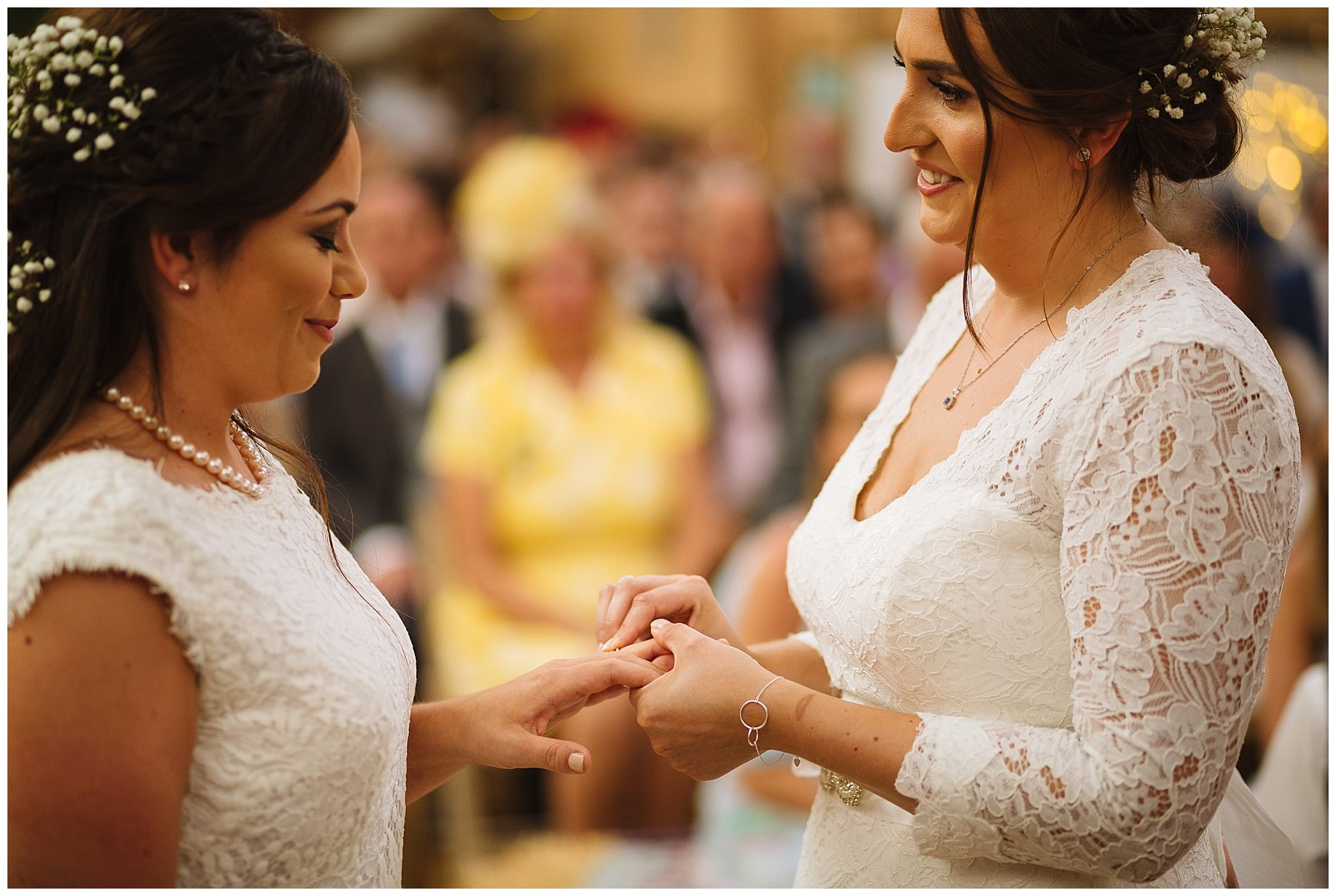 brides exchange rings during wellbeing farm wedding